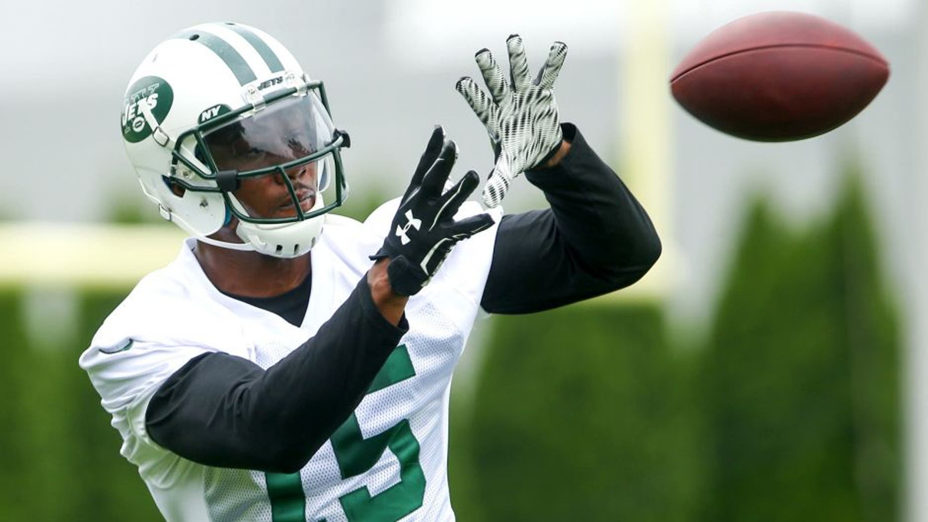 May 27, 2015; East Rutherford, NJ, USA; New York Jets wide receiver Brandon Marshall (15) catches a pass during organized team activities at Atlantic Health Jets Training Center. Mandatory Credit: Ed Mulholland-USA TODAY Sports