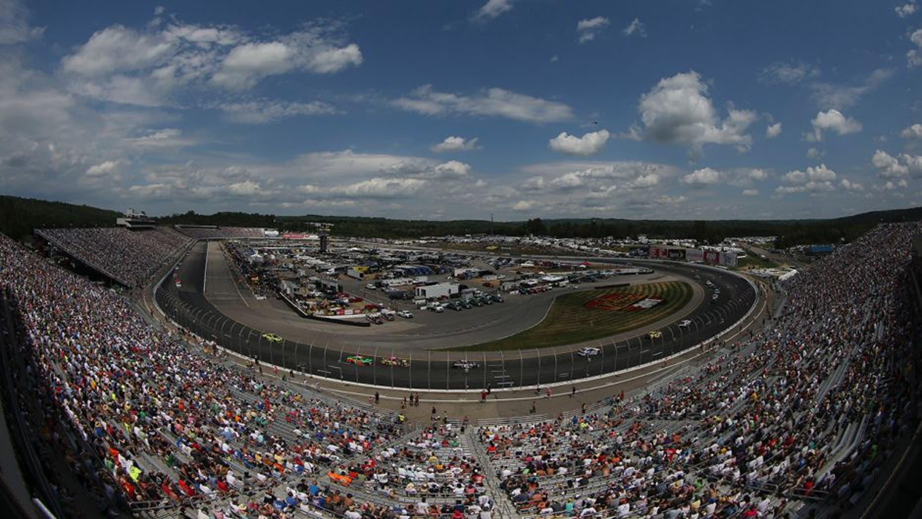 Drivers race during the NASCAR Sprint Cup Series 5-Hour ENERGY 301 at New Hampshire Motor Speedway on July 19, 2015 in Loudon, New Hampshire.