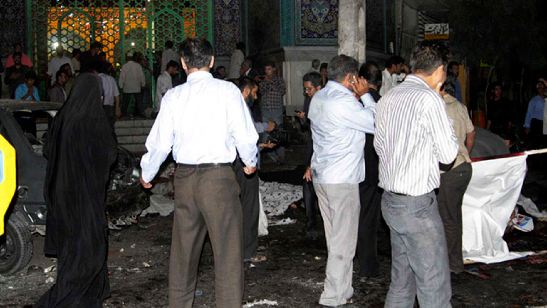 July 15: In this picture released by the Iran's official Islamic Republic News Agency (IRNA), people gather at the scene of bomb blasts in the provincial capital of Zahedan, Iran.