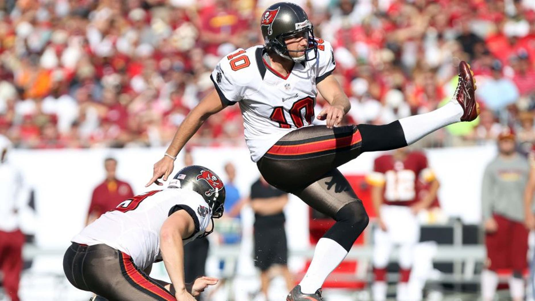 September 30, 2012; Tampa, FL, USA; Tampa Bay Buccaneers kicker Connor Barth (10) kicks a field goal during the first quarter against the Washington Redskins at Raymond James Stadium. Mandatory Credit: Kim Klement-USA TODAY Sports
