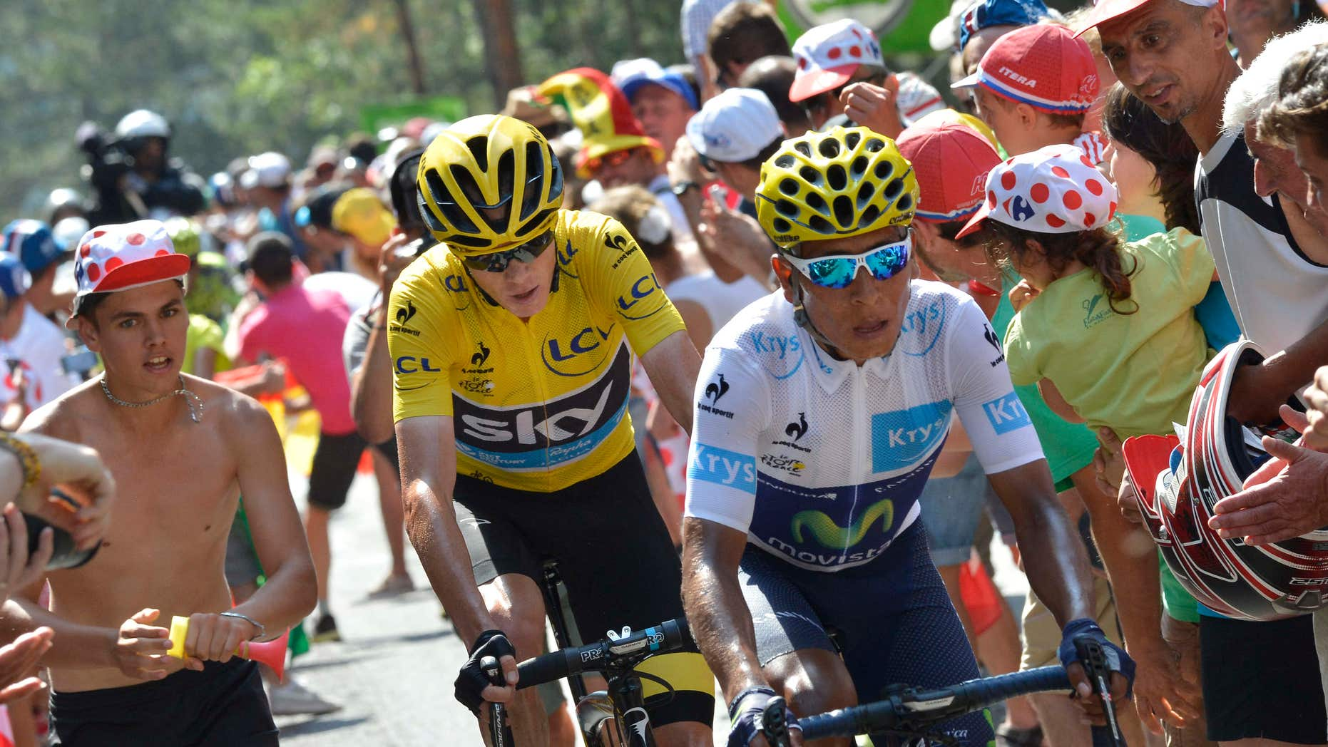 July 18, 2015: Colombia's Nairo Quintana, wearing the best young rider's white jersey, and Britain's Chris Froome, wearing the overall leader's yellow jersey, climb in the final kilometers of the fourteenth stage of the Tour de France cycling race over 178.5 kilometers (110.9 miles) with start in Rodez and finish in Mende, France.