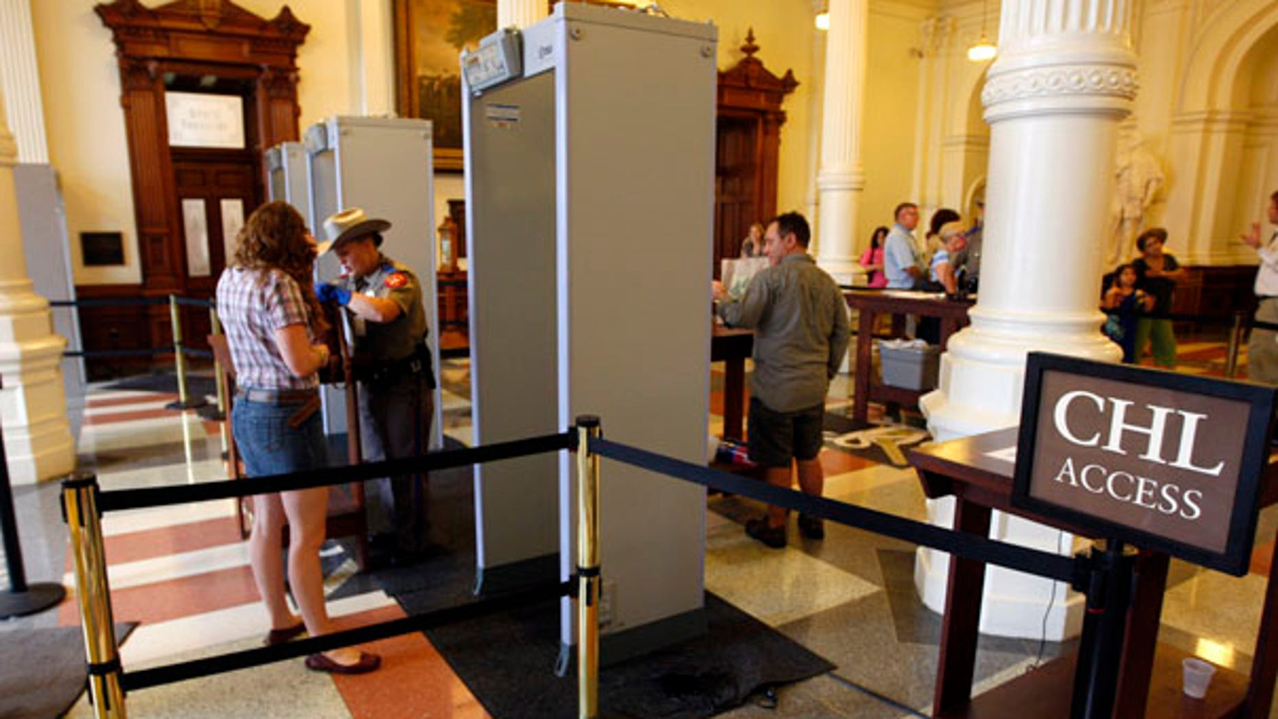 June 3: A sign offers an open lane for those with concealed handgun licenses (CHL) -- what many insiders consider an express pass gain access to the Texas Capitol in Austin.