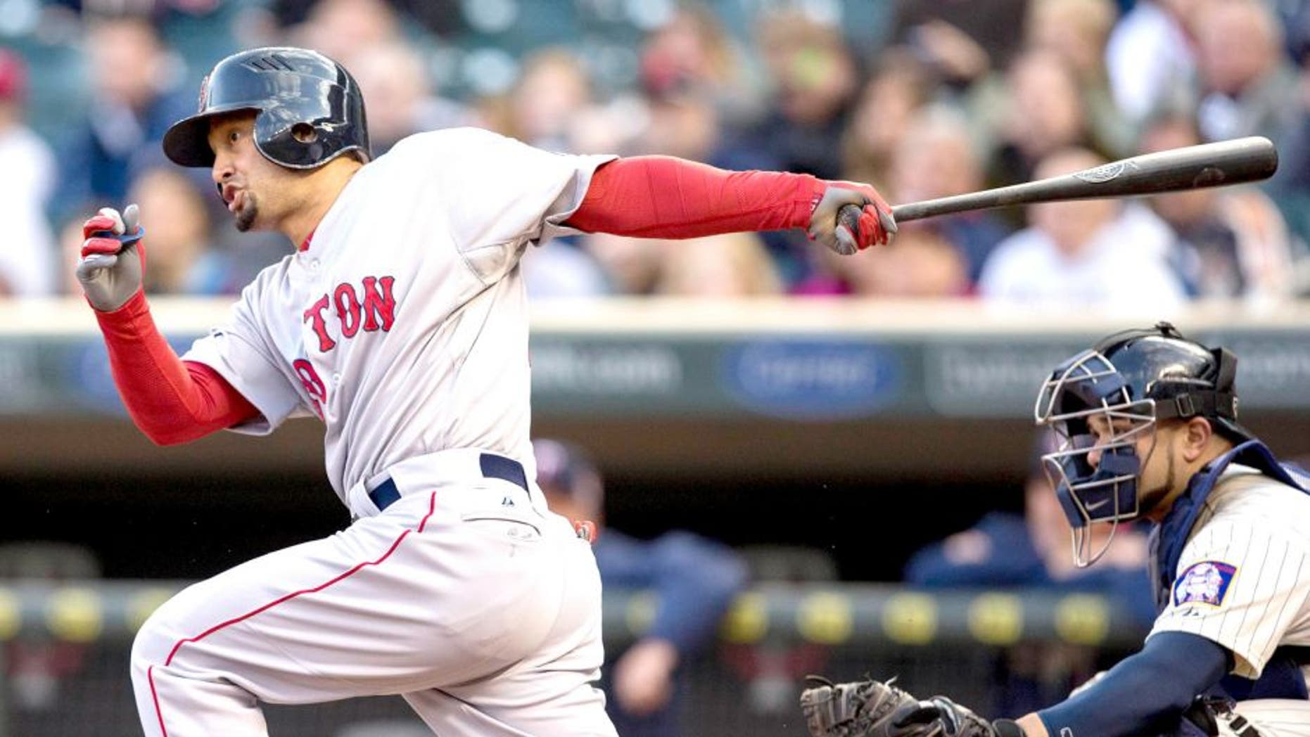 May 14, 2014; Minneapolis, MN, USA; Boston Red Sox right fielder Shane Victorino (18) hits a single in the first inning against the Minnesota Twins at Target Field. Mandatory Credit: Jesse Johnson-USA TODAY Sports