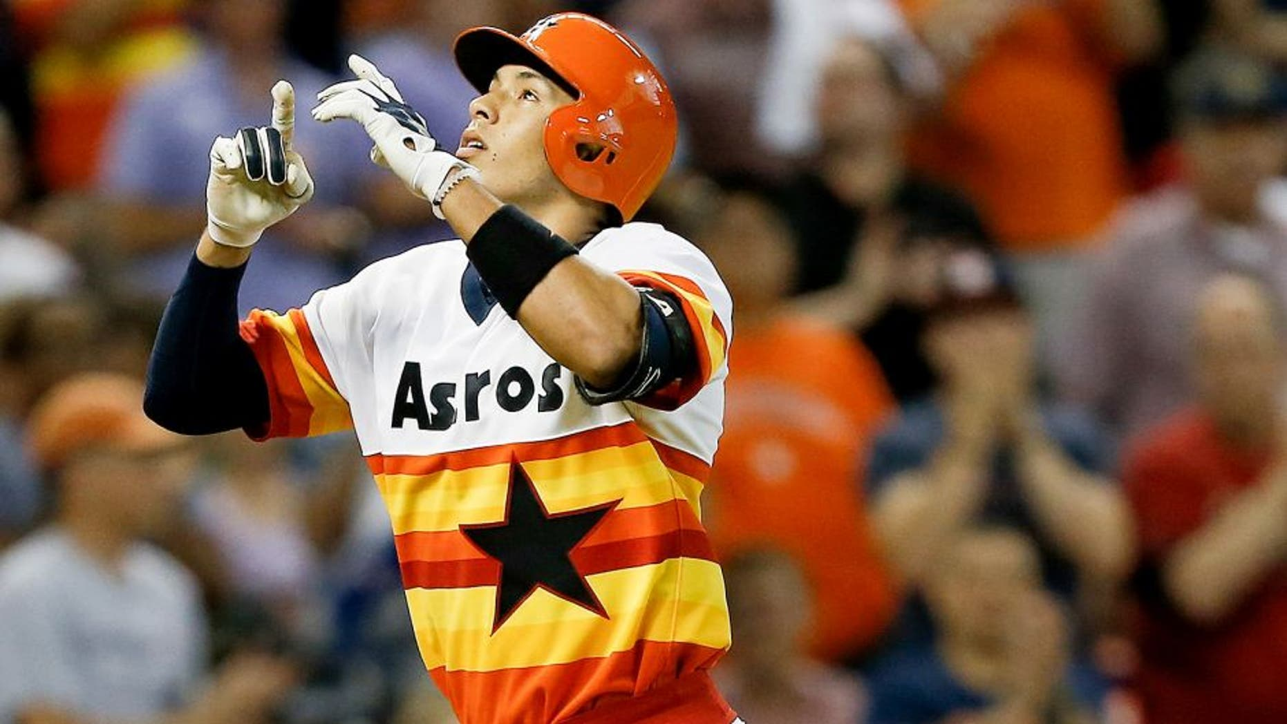 HOUSTON, TX - JULY 18: Carlos Correa #1 of the Houston Astros hits a home run in the seventh inning against the Texas Rangers at Minute Maid Park on July 18, 2015 in Houston, Texas. (Photo by Bob Levey/Getty Images)