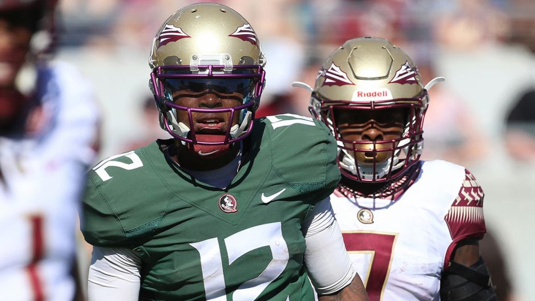 Apr 9, 2016; Orlando, FL, USA; Florida State Seminoles quarterback Deondre Francois (12) and running back Mario Pender (7) look to the sideline during the Florida State spring game at the Citrus Bowl. Mandatory Credit: Logan Bowles-USA TODAY Sports