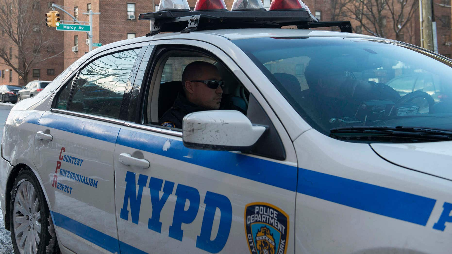 Jan. 9, 2015: A New York Police Department patrol vehicle is seen near the Marcy Houses public housing development in the Brooklyn borough of New York.