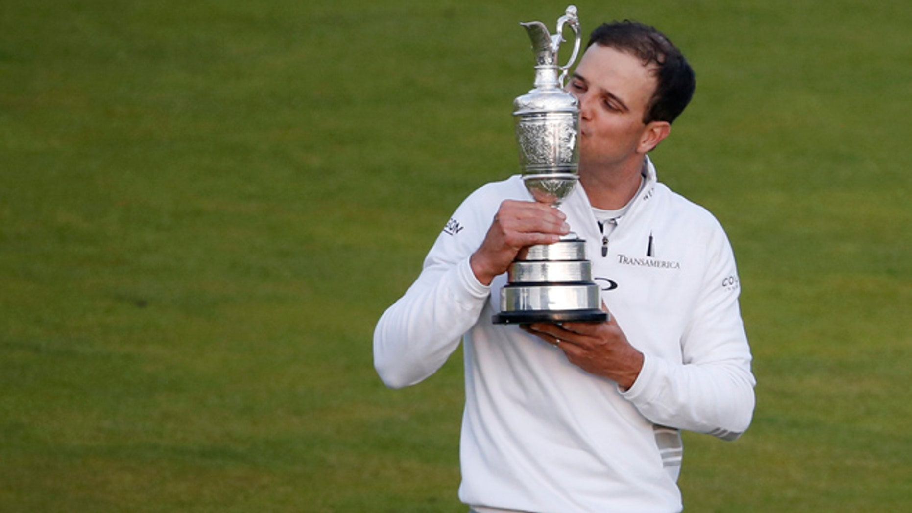 July 20, 20115: United States Zach Johnson kisses the trophy as he poses for photographers after winning a playoff after the final round at the British Open Golf Championship at the Old Course, St. Andrews, Scotland.