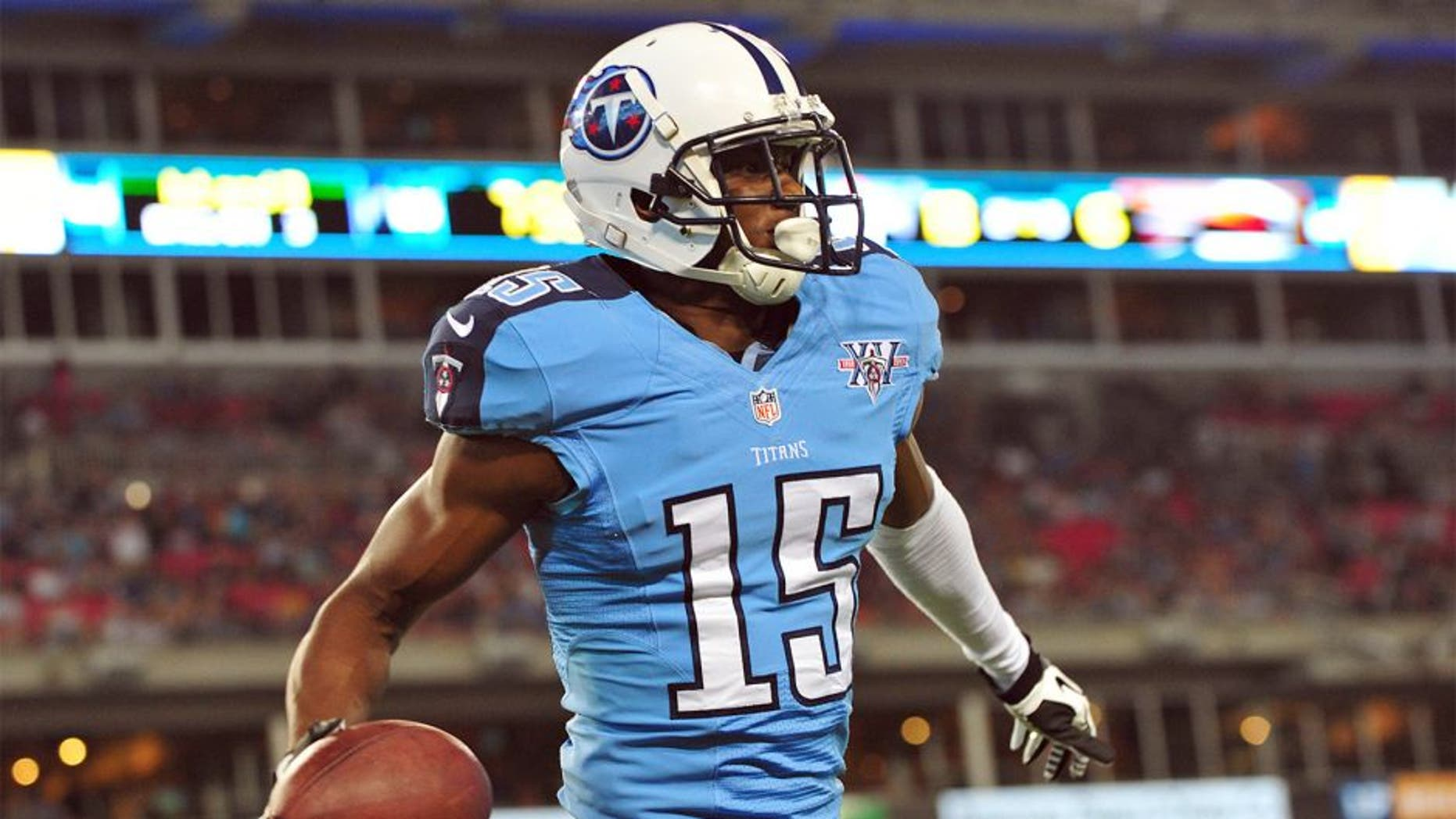 Aug 24, 2013; Nashville, TN, USA; Tennessee Titans wide receiver Justin Hunter (15) celebrates after scoring a touchdown against the Atlanta Falcons during the second half at LP Field. The Titans beat the Falcons 27-16. Mandatory Credit: Don McPeak-USA TODAY Sports