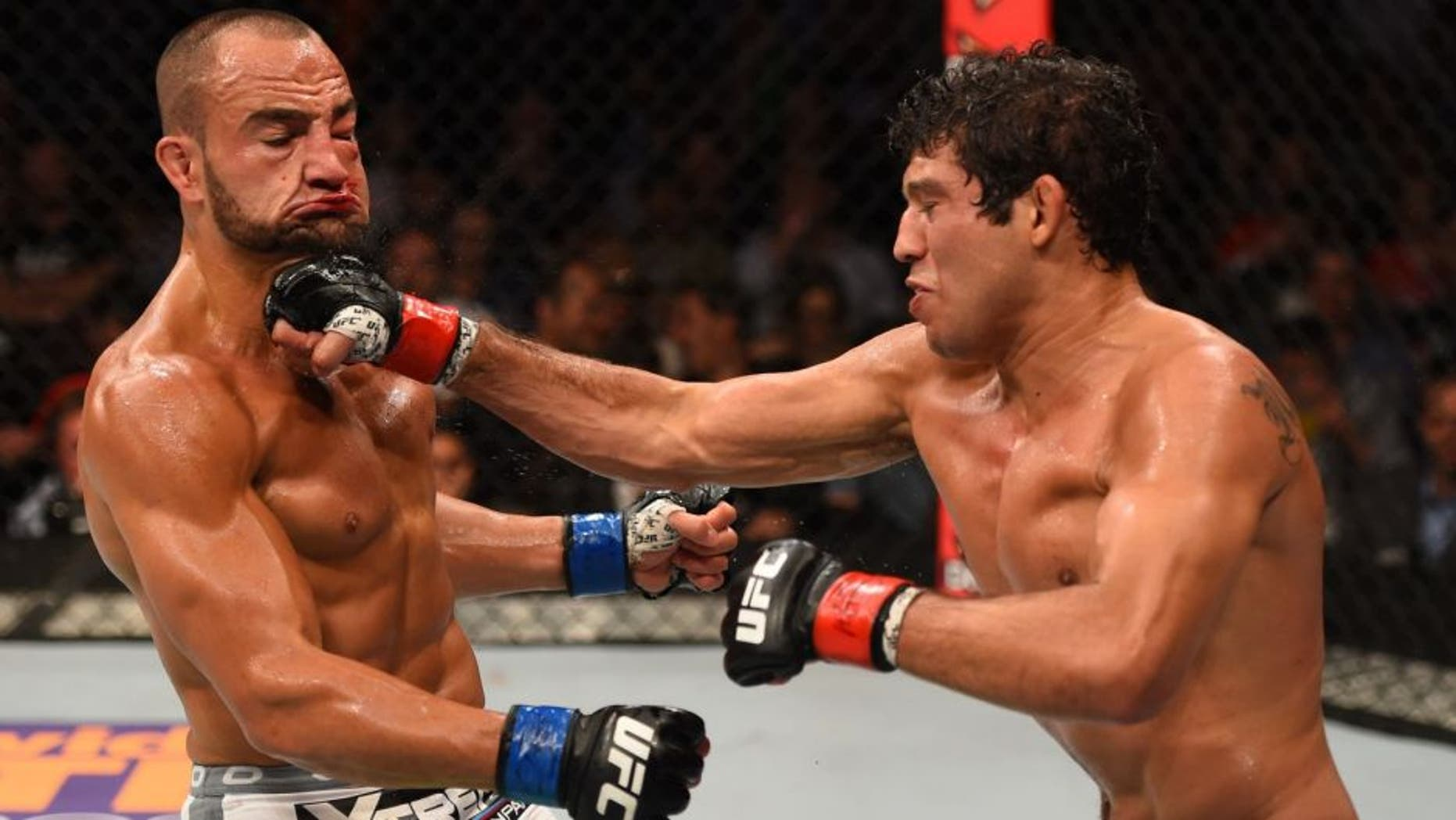 MEXICO CITY, MEXICO - JUNE 13: (R-L) Gilbert Melendez of the United States punches Eddie Alvarez of the United Statesin their lightweight bout during the UFC 188 event at the Arena Ciudad de Mexico on June 13, 2015 in Mexico City, Mexico. (Photo by Josh Hedges/Zuffa LLC/Zuffa LLC via Getty Images)