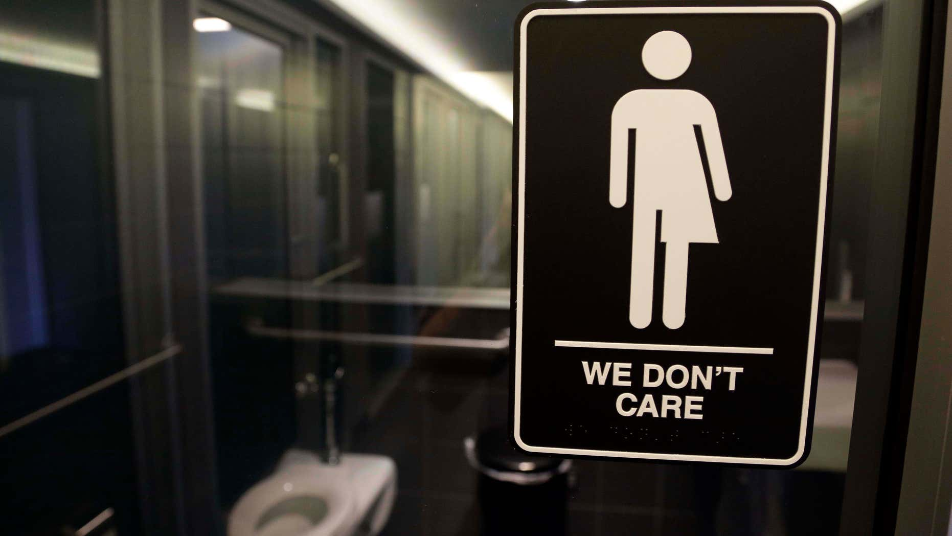 In this Thursday, May 12, 2016 file photo, signage is seen outside a restroom at 21c Museum Hotel in Durham, N.C.