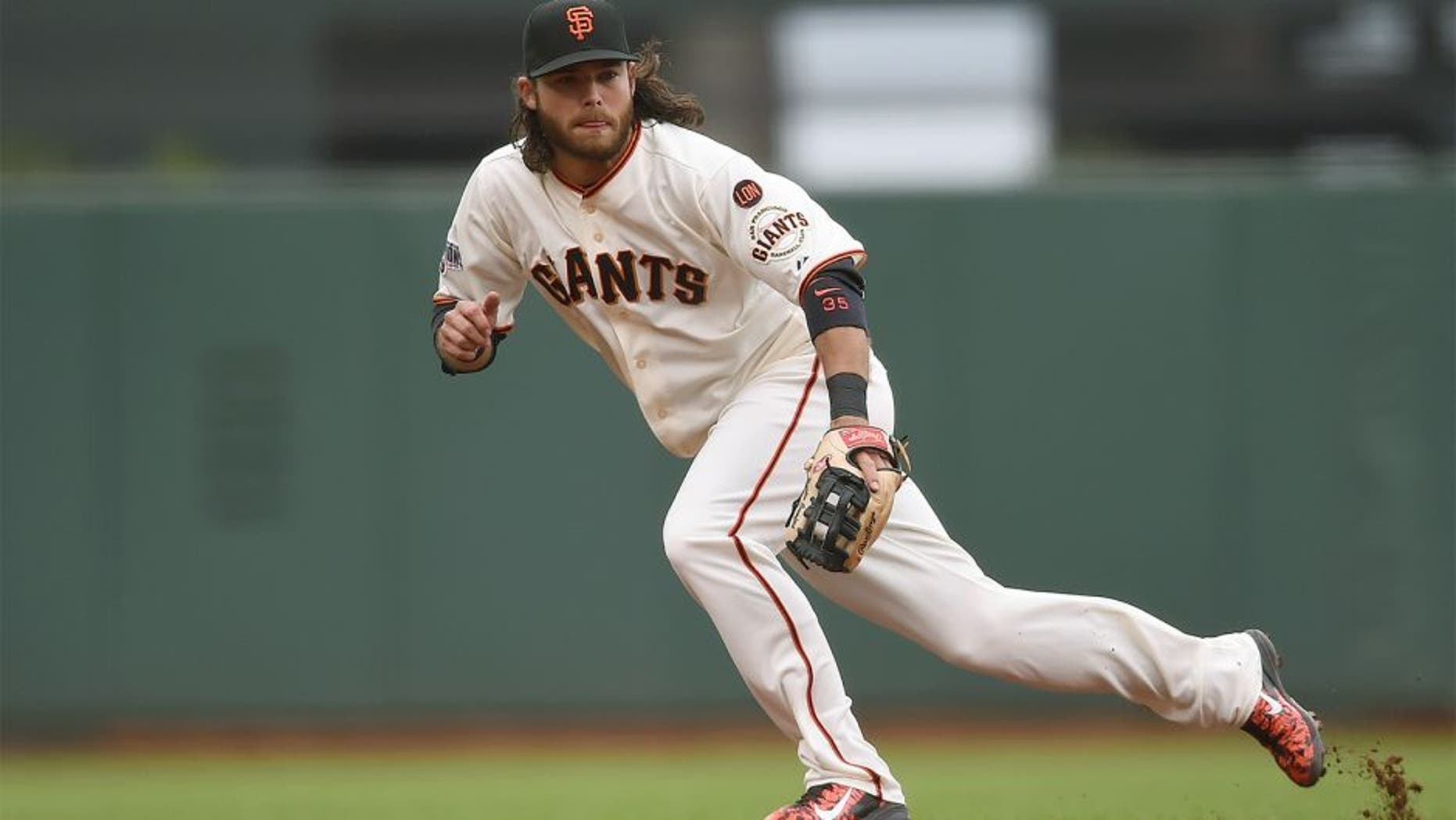 SAN FRANCISCO, CA - JULY 08: Brandon Crawford #35 of the San Francisco Giants reacts to his right of a ball that goes for a basehit off the bat of Wilmer Flores #4 of the New York Mets in the top of the fourth inning at AT&T Park on July 8, 2015 in San Francisco, California. (Photo by Thearon W. Henderson/Getty Images)