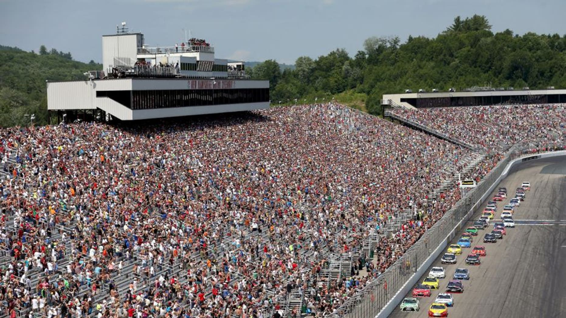 LOUDON, NH - JULY 19: Carl Edwards, driver of the #19 Sport Clips Toyota, leads the field to turn one after taking the green flag to start the NASCAR Sprint Cup Series 5-Hour ENERGY 301 at New Hampshire Motor Speedway on July 19, 2015 in Loudon, New Hampshire. (Photo by Nick Laham/Getty Images)