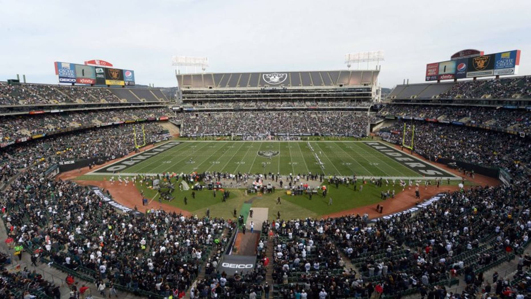 Nov 3, 2013; Oakland, CA, USA; General view of the opening kickoff between the Philadelphia Eagles and the Oakland Raiders at O.co Coliseum. The Eagles defeated the Raiders 49-20. Mandatory Credit: Kirby Lee-USA TODAY Sports