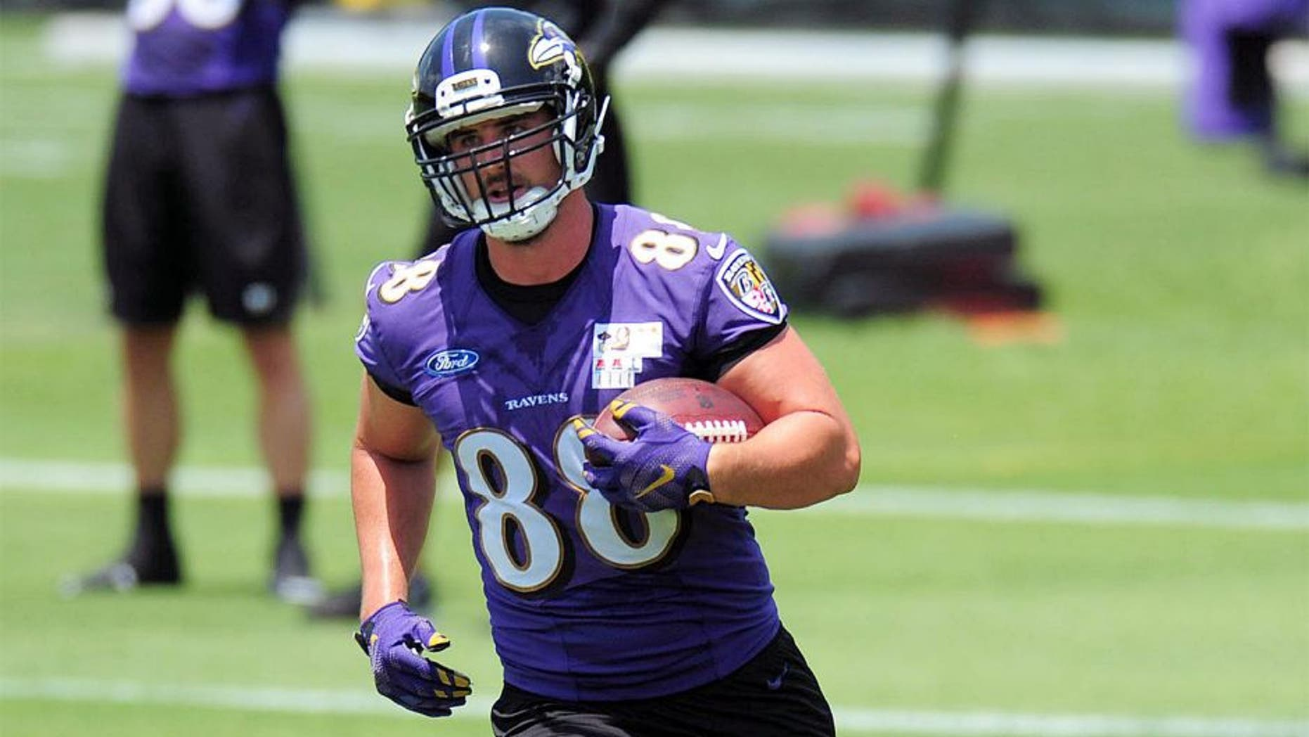 May 28, 2015; Baltimore, MD, USA; Baltimore Ravens tight end Dennis Pitta (88) runs with the ball during training camp at the Under Armour Performance Center. Mandatory Credit: Evan Habeeb-USA TODAY Sports