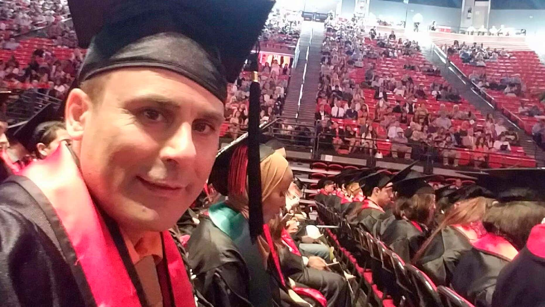 In this May 2016 photo released by a family member shows Robin Shahini during his International Security and Conflict Resolution San Diego State University graduation ceremony in San Diego, Calif.