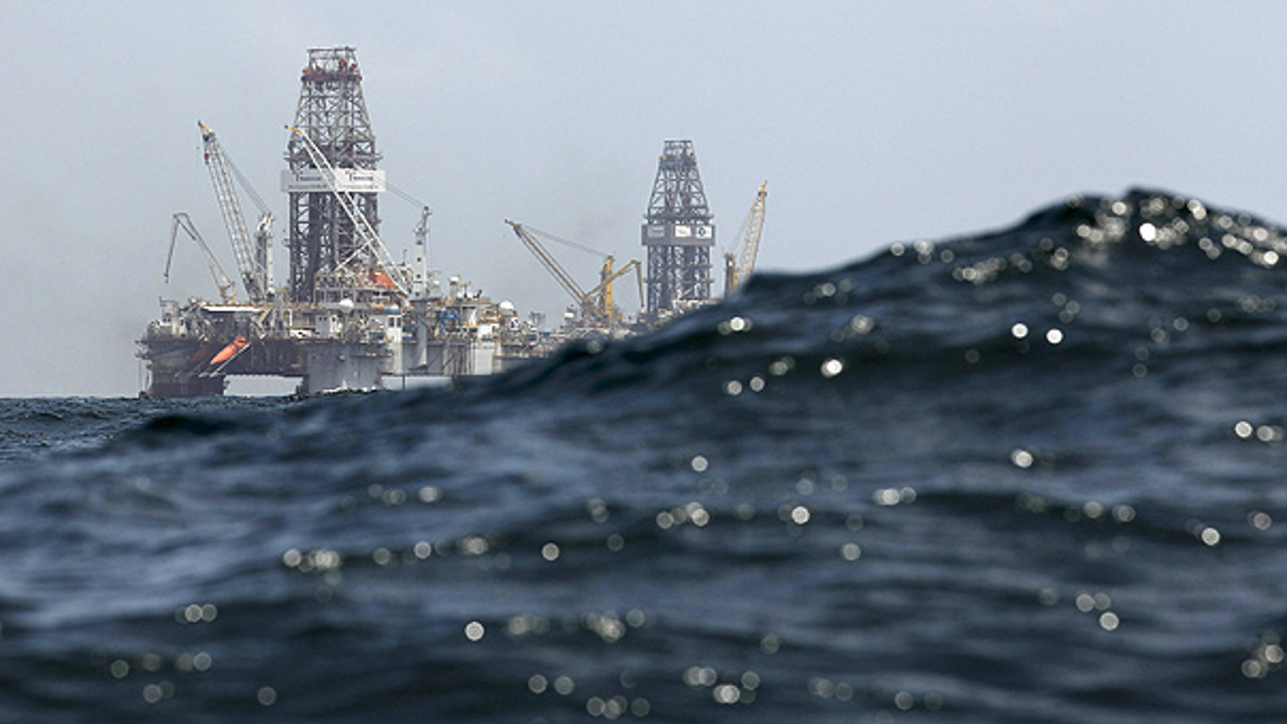 July 22: Waves partially obscure rigs drilling the relief wells at the Deepwater Horizon oil spill site in the Gulf of Mexico.