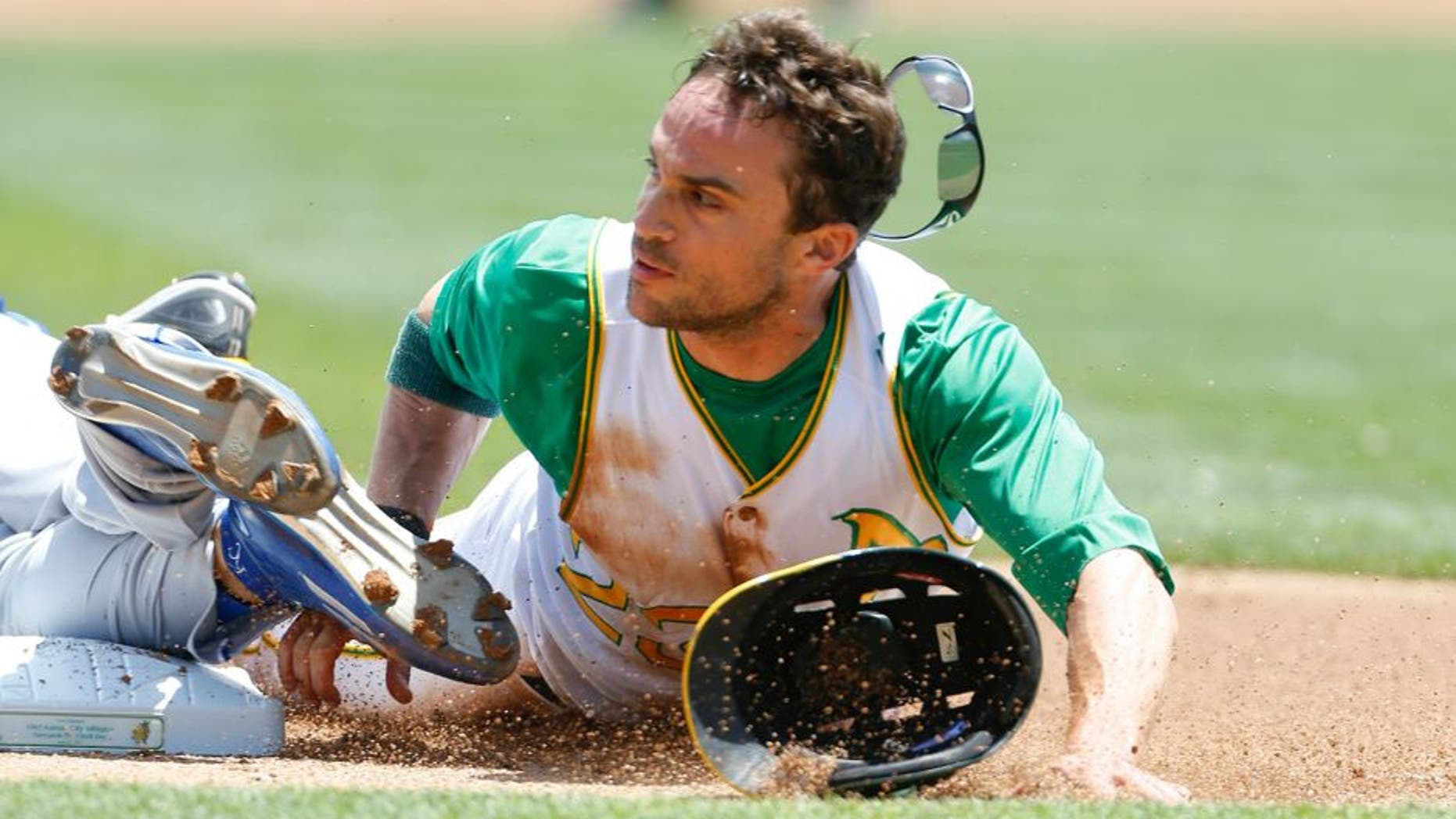 OAKLAND, CA - JUNE 27: Sam Fuld #23 of the Oakland Athletics slides safely into third, on a triple, during the game against the Kansas City Royals at O.co Coliseum on June 27, 2015 in Oakland, California. The Royals defeated the Athletics 3-2. (Photo by Michael Zagaris/Oakland Athletics/Getty Images)