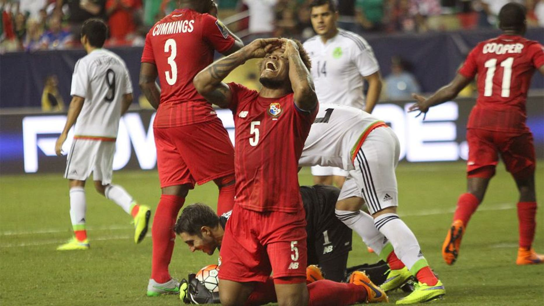ATLANTA, UNITED STATES - July 22: Roman Torres of Panama reacts after the referee called a penalty during a semi final match between Mexico and Panama as part of Gold Cup 2015 at Georgia Dome on July 22, 2015 in Atlanta, United States. (Photo by Omar Vega/LatinContent/Getty Images)