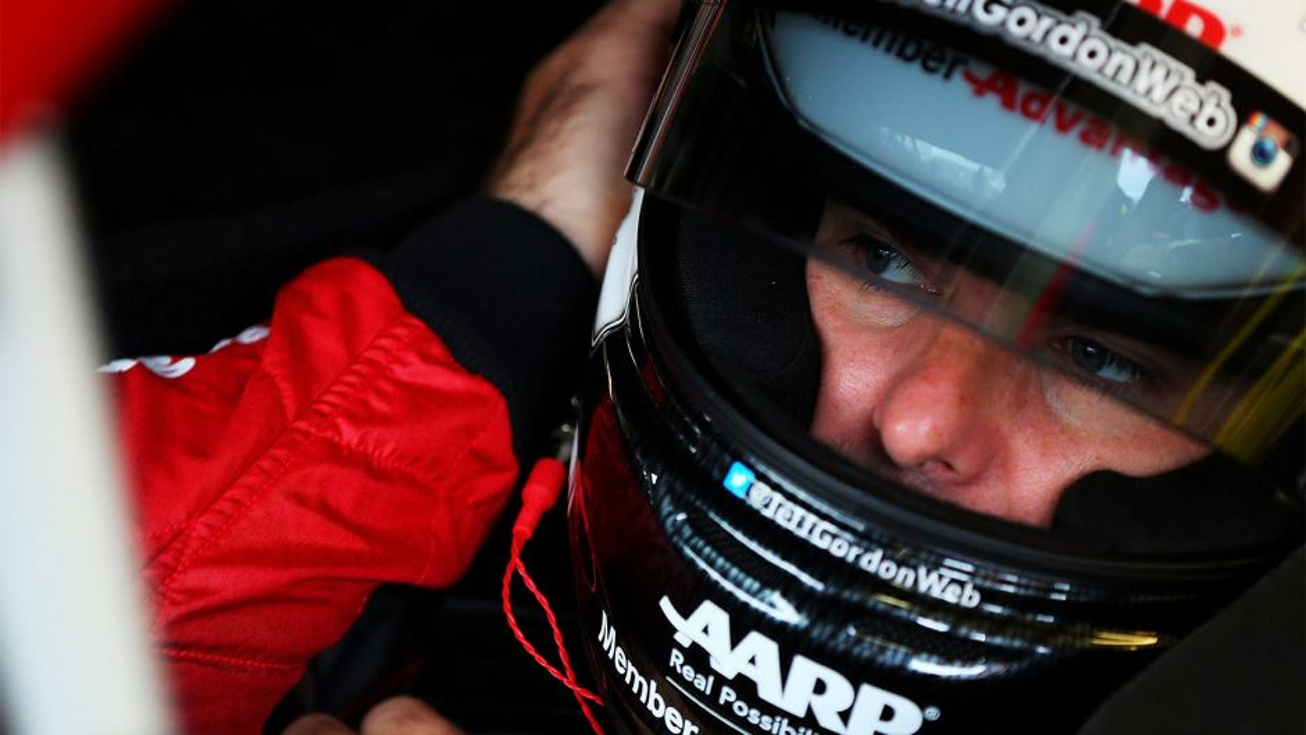 SPARTA, KY - JULY 10: Jeff Gordon, driver of the #24 AARP Member Advantages Chevrolet, prepares his helmet in the garage area during practice for the NASCAR Sprint Cup Series Quaker State 400 Presented by Advance Auto Parts at Kentucky Speedway on July 10, 2015 in Sparta, Kentucky. (Photo by Matt Sullivan/NASCAR via Getty Images)