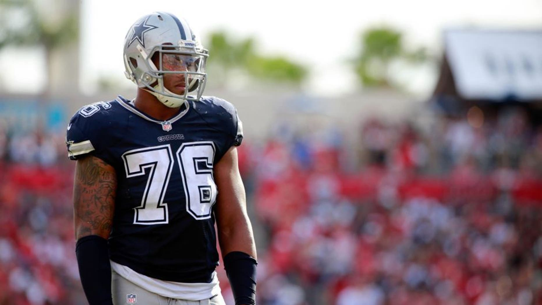 Nov 15, 2015; Tampa, FL, USA; Dallas Cowboys defensive end Greg Hardy (76) looks on against the Tampa Bay Buccaneers during the second half at Raymond James Stadium. Tampa Bay Buccaneers defeated the Dallas Cowboys 10-6. Mandatory Credit: Kim Klement-USA TODAY Sports