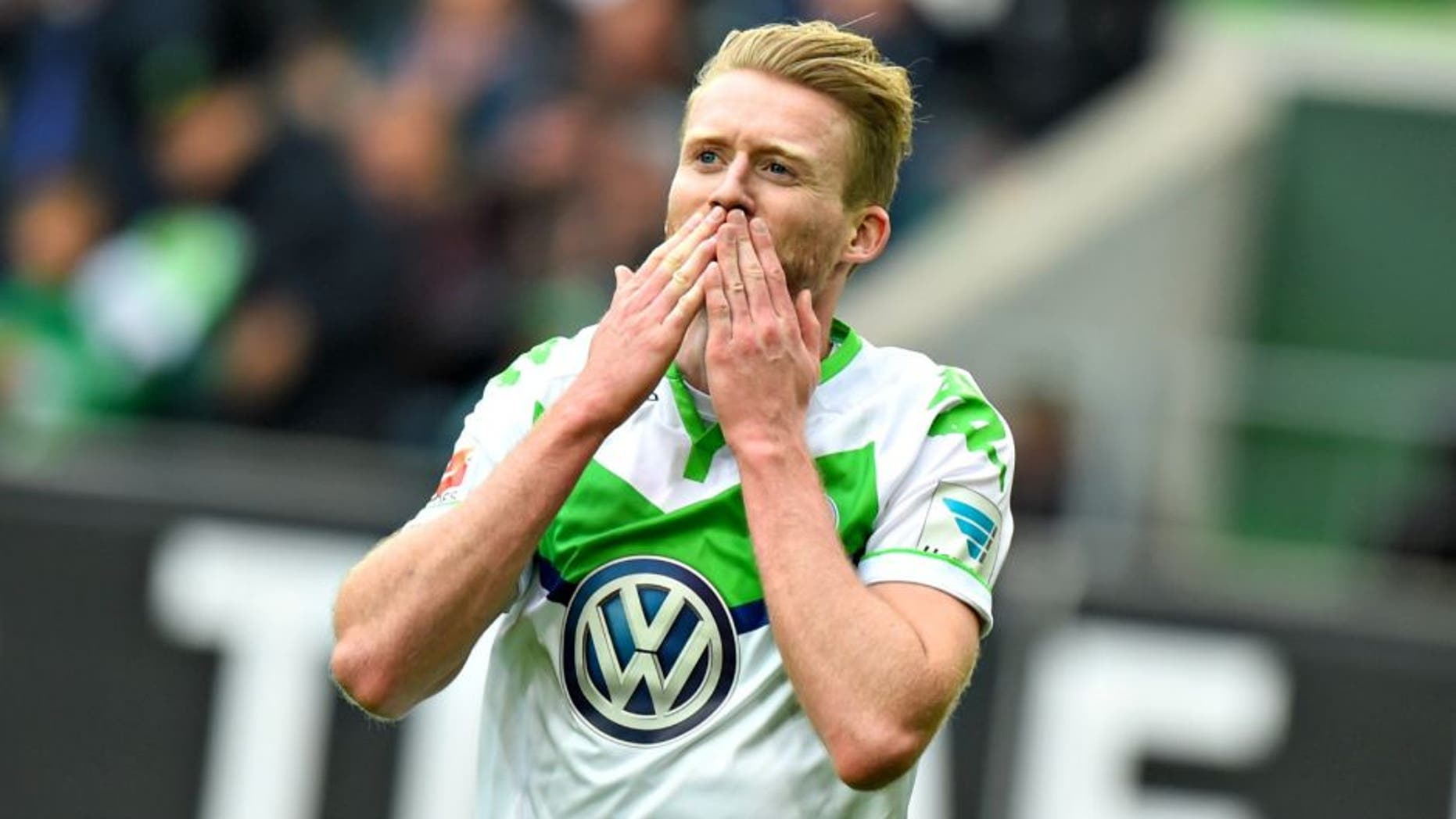 WOLFSBURG, GERMANY - MAY 14: Andre Schuerrle of Wolfsburg celebrates scoring his second goal during during the Bundesliga match between VfL Wolfsburg and VfB Stuttgart at Volkswagen Arena on May 14, 2016 in Wolfsburg, Germany. (Photo by Nigel Treblin/Bongarts/Getty Images)