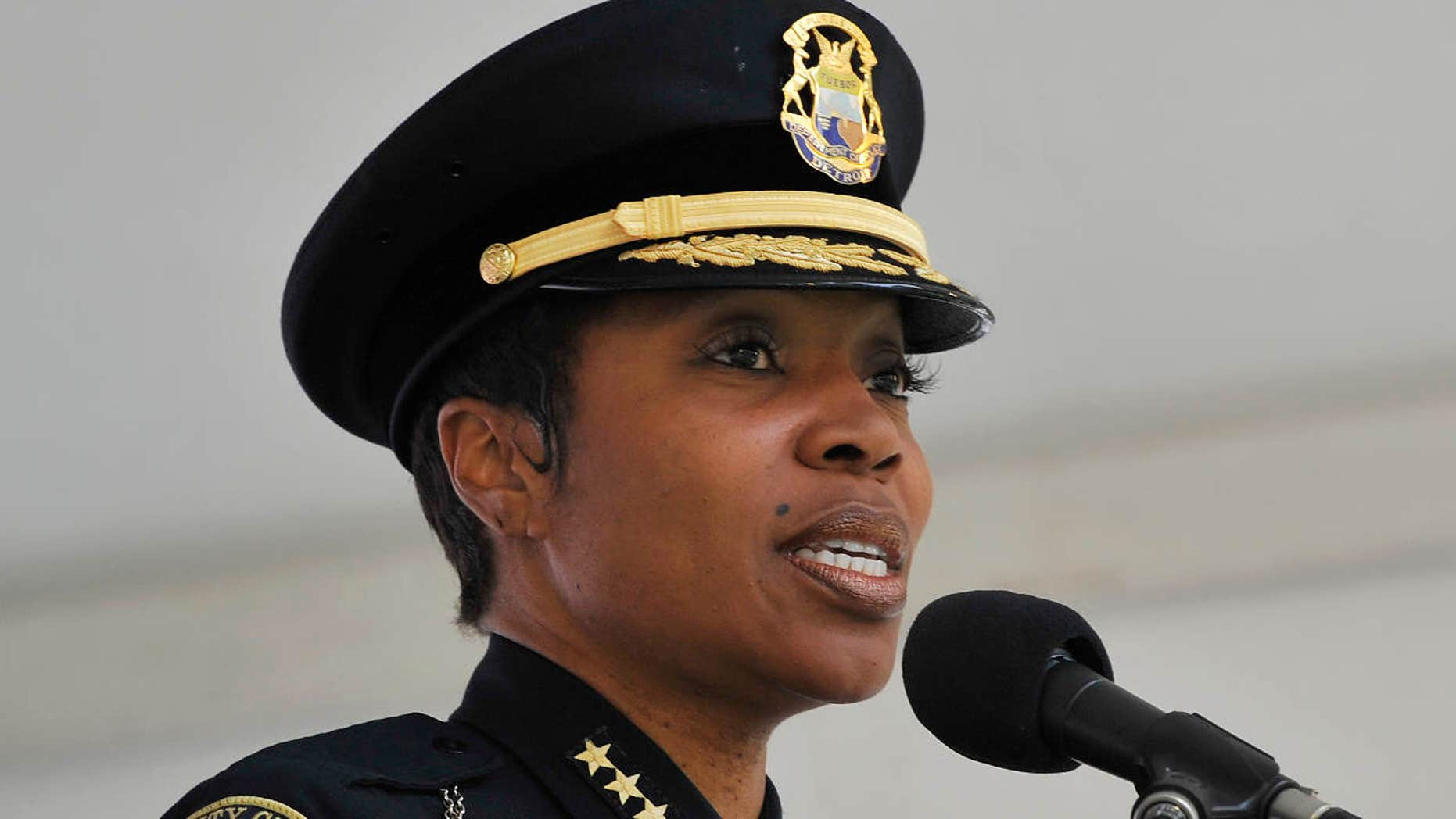 "In this June 11, 2015, photo, Detroit Police Deputy Chief Renee Hall speaks before a group of ""Detroit Ambassadors"" during a swearing-in ceremony in Campus Martius Park in Detroit."