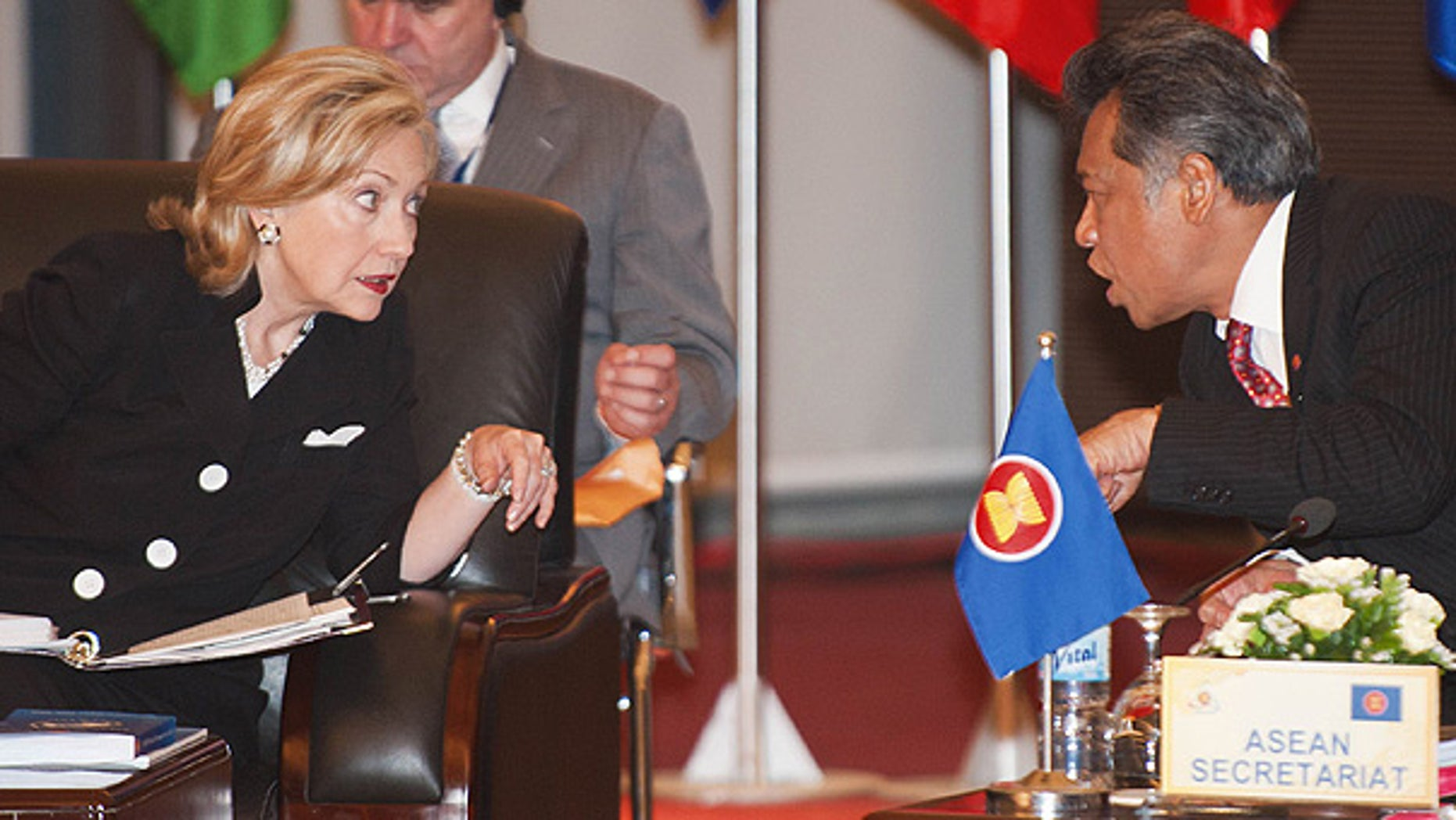 July 23:  Secretary of State Hillary Clinton speaks with ASEAN Secretary Surin Pitsuwan during 17th ASEAN Regional forum Retreat meeting in Hanoi.