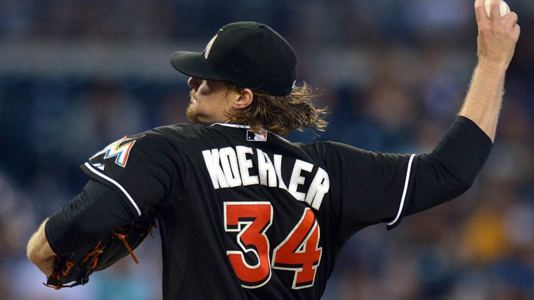 Jul 23, 2015; San Diego, CA, USA; Miami Marlins starting pitcher Tom Koehler (34) pitches against the San Diego Padres during the third inning at Petco Park. Mandatory Credit: Jake Roth-USA TODAY Sports