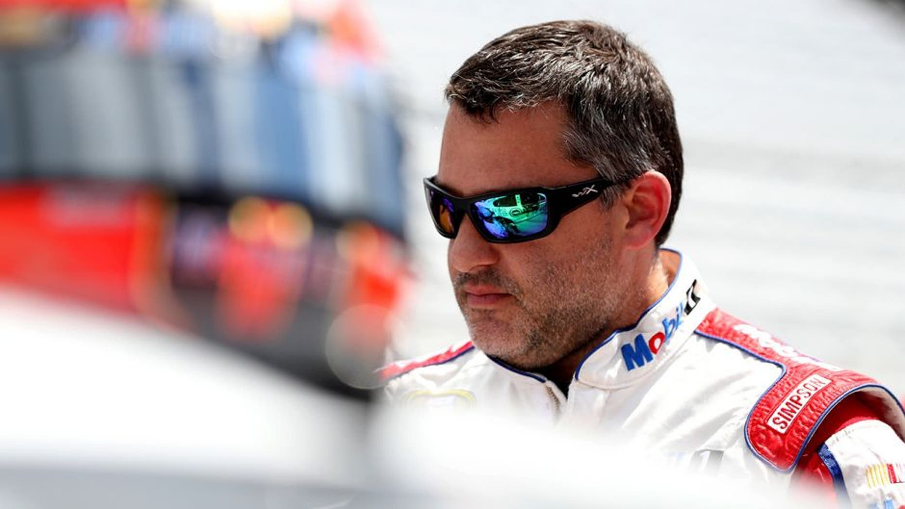 INDIANAPOLIS, IN - JULY 23: Tony Stewart, driver of the #14 Mobil 1/Chevy Summer Sell Down Chevrolet, stands on the grid during qualifying for the NASCAR Sprint Cup Series Crown Royal Presents The Combat Wounded Coalition 400 at Indianapolis Motor Speedway on July 23, 2016 in Indianapolis, Indiana. (Photo by Sean Gardner/NASCAR via Getty Images)