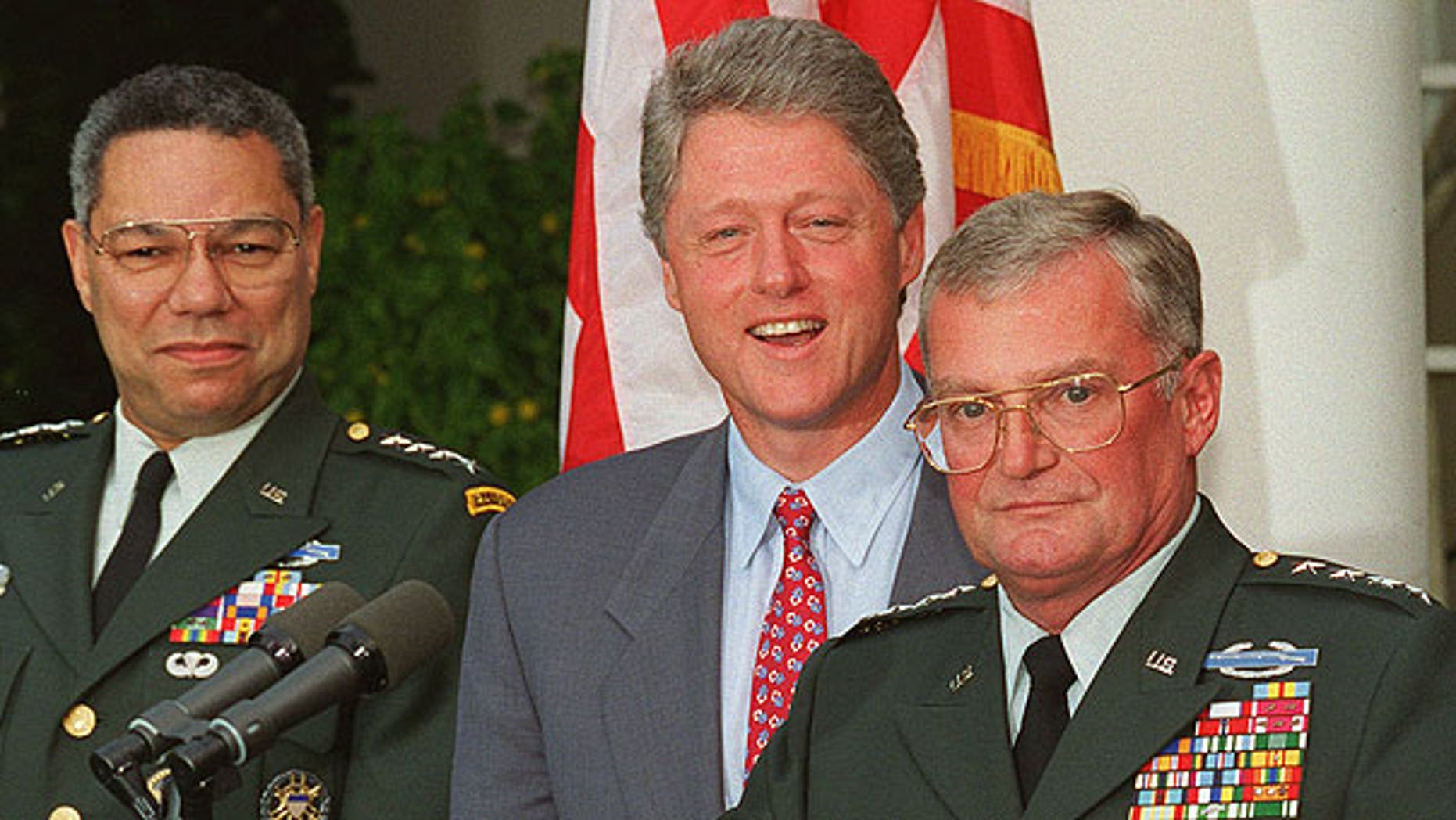 In this Aug. 11, 1993 file photo, Army Gen. John Shalikashvili speaks in the Rose Garden of the White House in Washington accompanied by President Bill Clinton and Joint Chiefs Chairman Gen. Colin Powell.