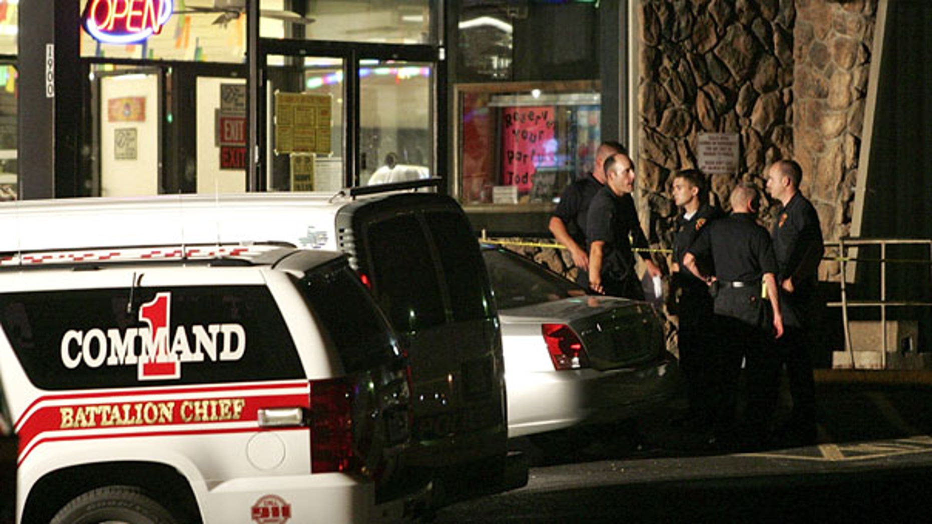 July 23: Emergency personnel wait outside the scene of a shooting at a roller rink in Grand Prairie, Texas  A police chief says a gunman has died of a self-inflicted gunshot wound after killing five other people and injuring three at the roller rink.