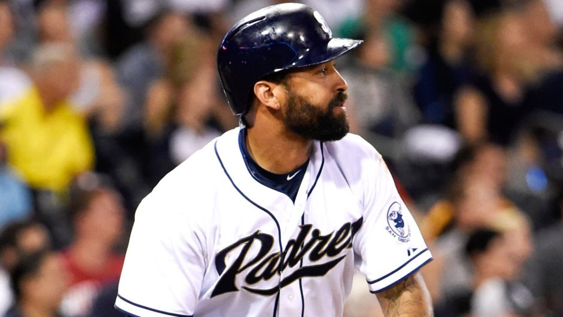 SAN DIEGO, CA - JULY 23: Matt Kemp #27 of the San Diego Padres tosses his bat after hitting a long fly ball during the fourth inning of a baseball game against the Miami Marlins at Petco Park July 23, 2015 in San Diego, California. (Photo by Denis Poroy/Getty Images)