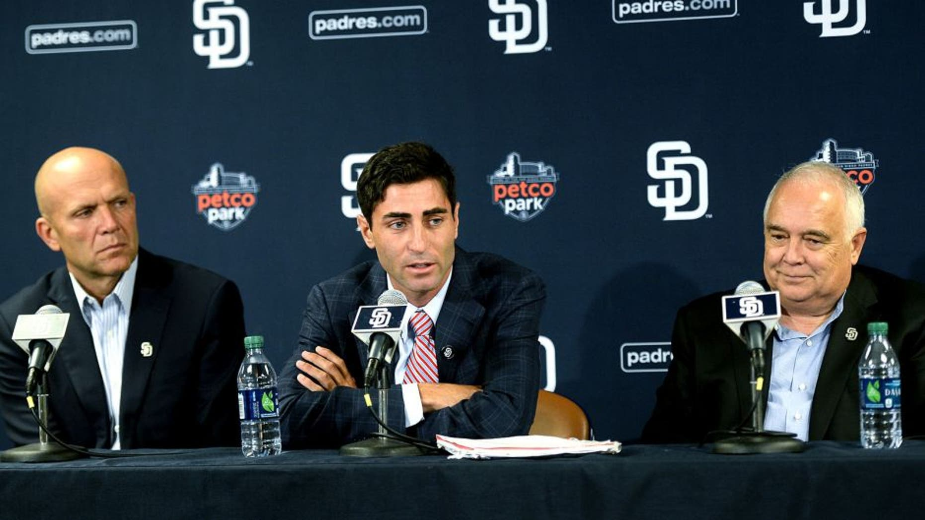 SAN DIEGO, CA - AUGUST 6: President & Chief Executive Officer Mike Dee and Executive Chairman Ron Fowler of the San Diego Padres listen as A.J. Preller speaks with the media as he is named the new General Manager of the San Diego Padres at a press conference at Petco Park on August 6, 2014 in San Diego, California. (Photo by Andy Hayt/San Diego Padres/Getty Images) *** LOCAL CAPTION *** A.J. Preller;Mike Dee;Ron Fowler