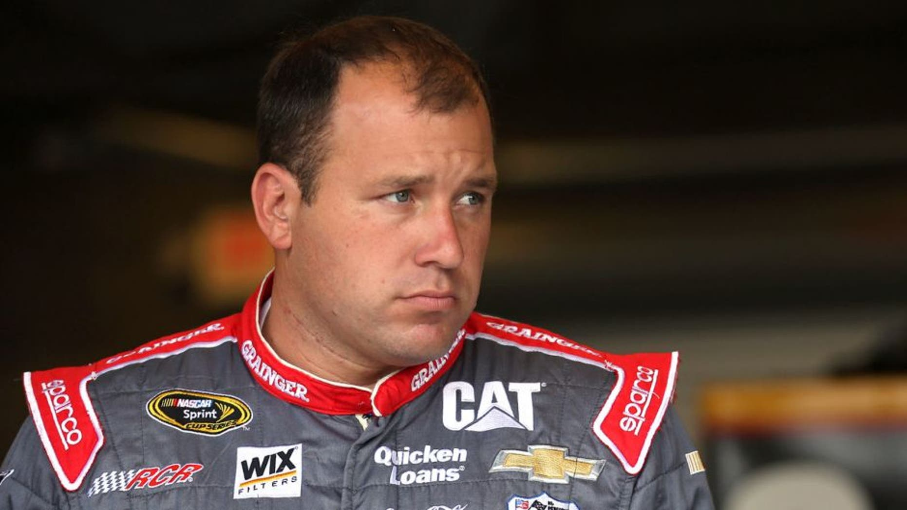 INDIANAPOLIS, IN - JULY 24: Ryan Newman, driver of the #31 Grainger Chevrolet, stands in the garage area during practice for the NASCAR Sprint Cup Series Crown Royal Presents the Jeff Kyle 400 at the Brickyard at Indianapolis Motorspeedway on July 24, 2015 in Indianapolis, Indiana. (Photo by Chris Graythen/Getty Images)