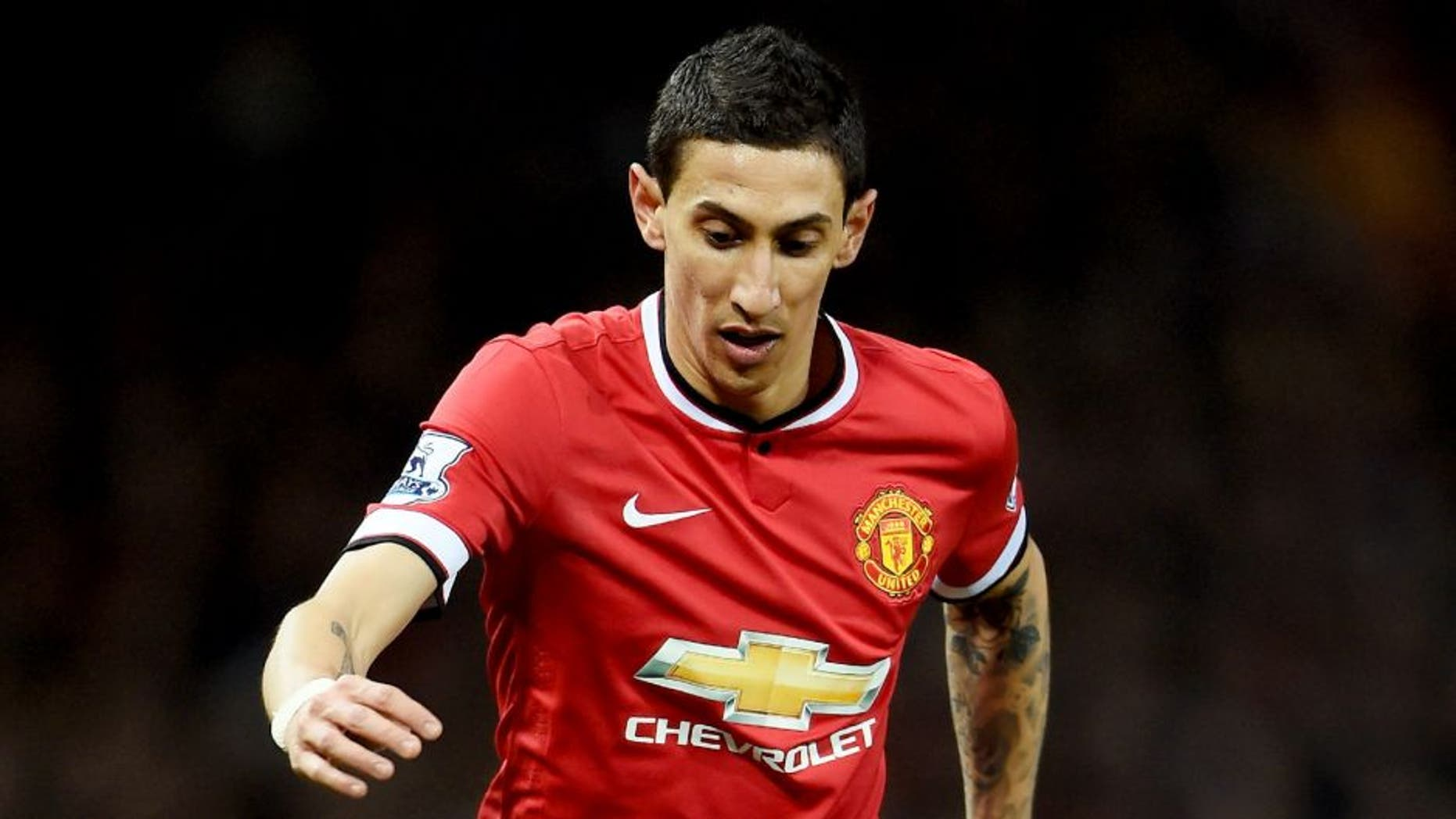 MANCHESTER, ENGLAND - MARCH 09: Angel di Maria of Manchester United controls the ball during the FA Cup Quarter Final match between Manchester United and Arsenal at Old Trafford on March 9, 2015 in Manchester, England. (Photo by Laurence Griffiths/Getty Images)
