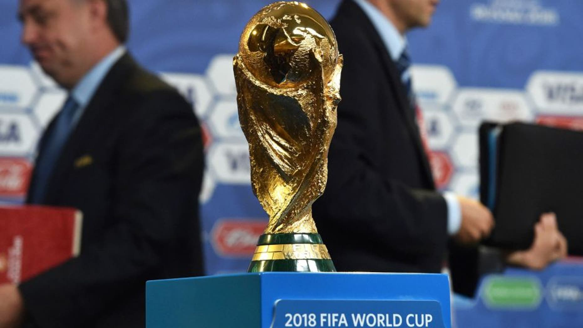 The FIFA World Cup trophy stands on a podium at a hall close to the Constantine (Konstantinovsky) Palace in St. Petersburg on July 24, 2015 on the eve of the Preliminary draw for the 2018 FIFA World Cup. The trophy created by Italian sculptor Silvio Gazzaniga for the 1974 World Cup, measures 36cm in height, is made out of 18-carat gold and weighs 6175g. AFP PHOTO / KIRILL KUDRYAVTSEV (Photo credit should read KIRILL KUDRYAVTSEV/AFP/Getty Images)