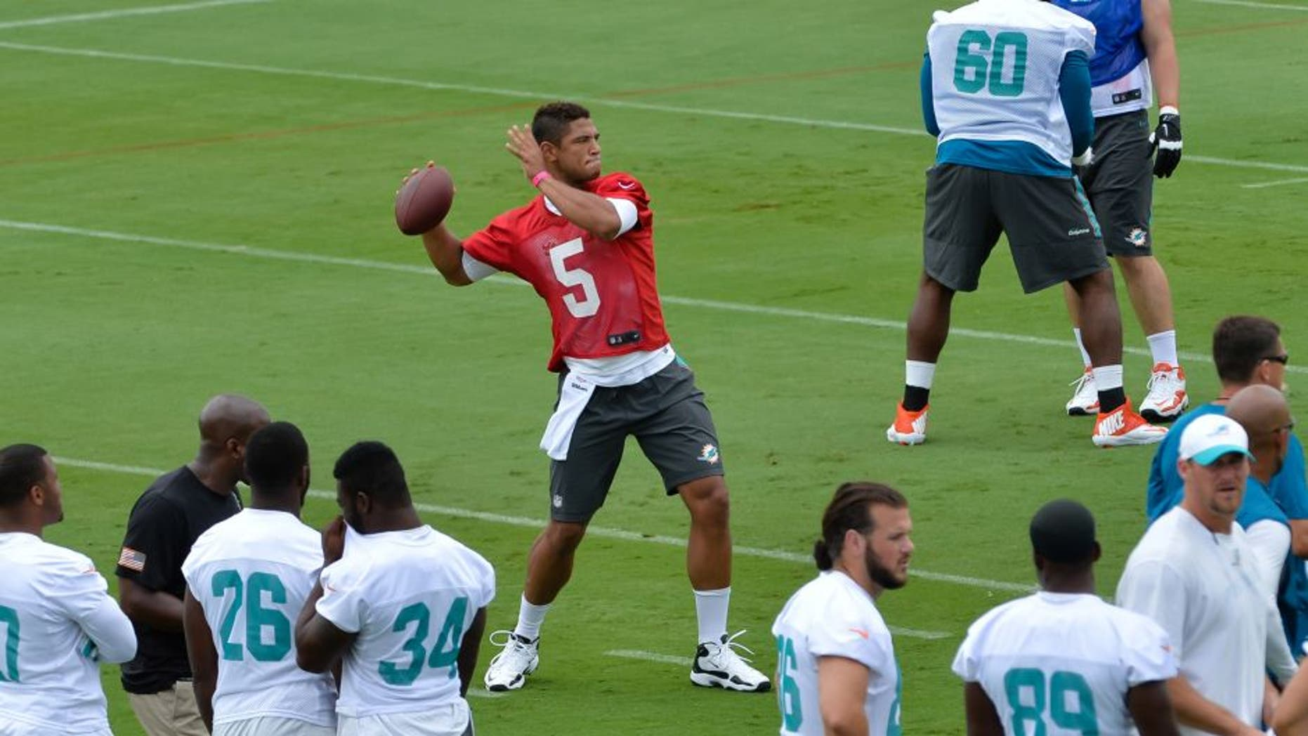 May 26, 2015; Miami, FL, USA; Miami Dolphins quarterback Josh Freeman (5) during practice drills at Miami Dolphins Training Facility. Mandatory Credit: Steve Mitchell-USA TODAY Sports