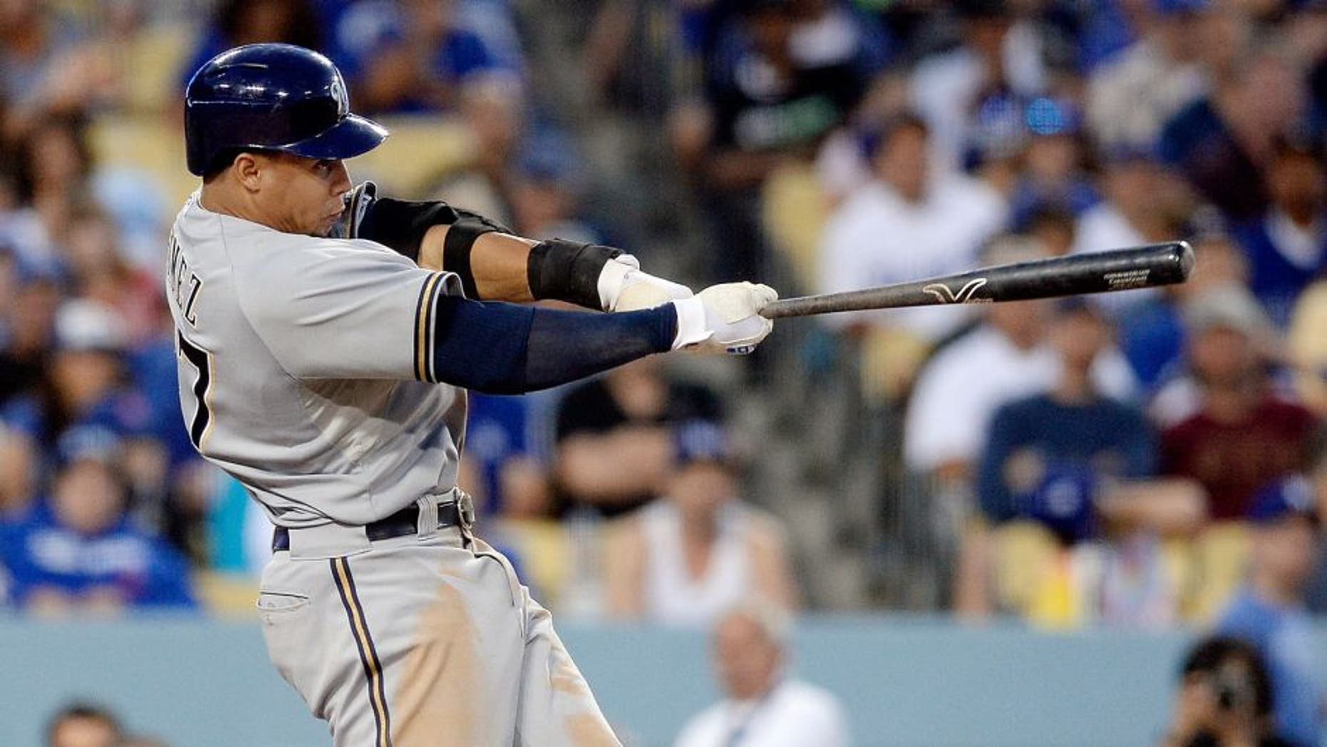 LOS ANGELES, CA - JULY 11: Carlos Gomez #27 of the Milwaukee Brewers hits a three run double during the third inning of the baseball game July 11, 2015 at Dodger Stadium in Los Angeles, California. (Photo by Kevork Djansezian/Getty Images)