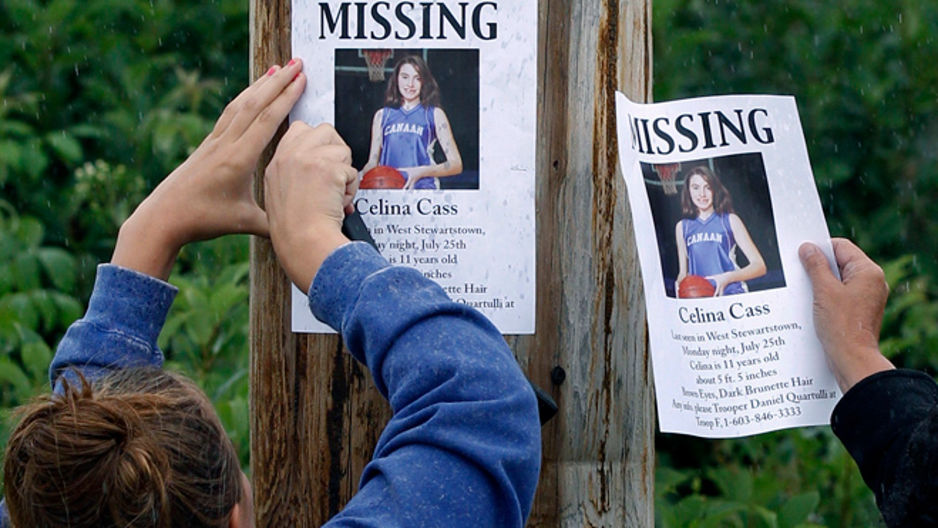 July 28, 2011: file photo, Kaylin Pettit, of Stewartstown, N.H., left, and Lori McKearney, of Lancaster, N.H. tack missing posters for Celina Cass to a utility pole in Colebrook, N.H.