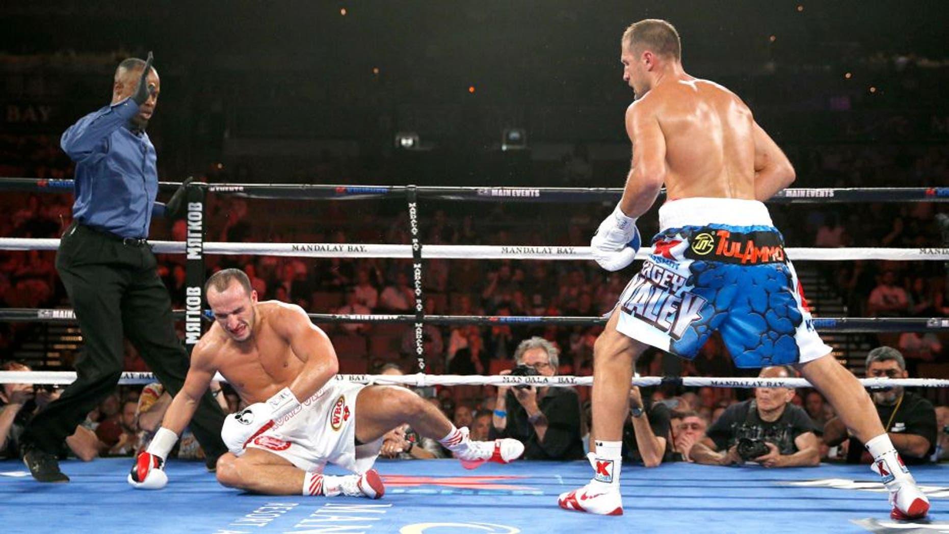 Sergey Kovalev knocks down Nadjib Mohammedi to win their light heavyweight title boxing bout Saturday, July 25, 2015, in Las Vegas. (AP Photo/John Locher)