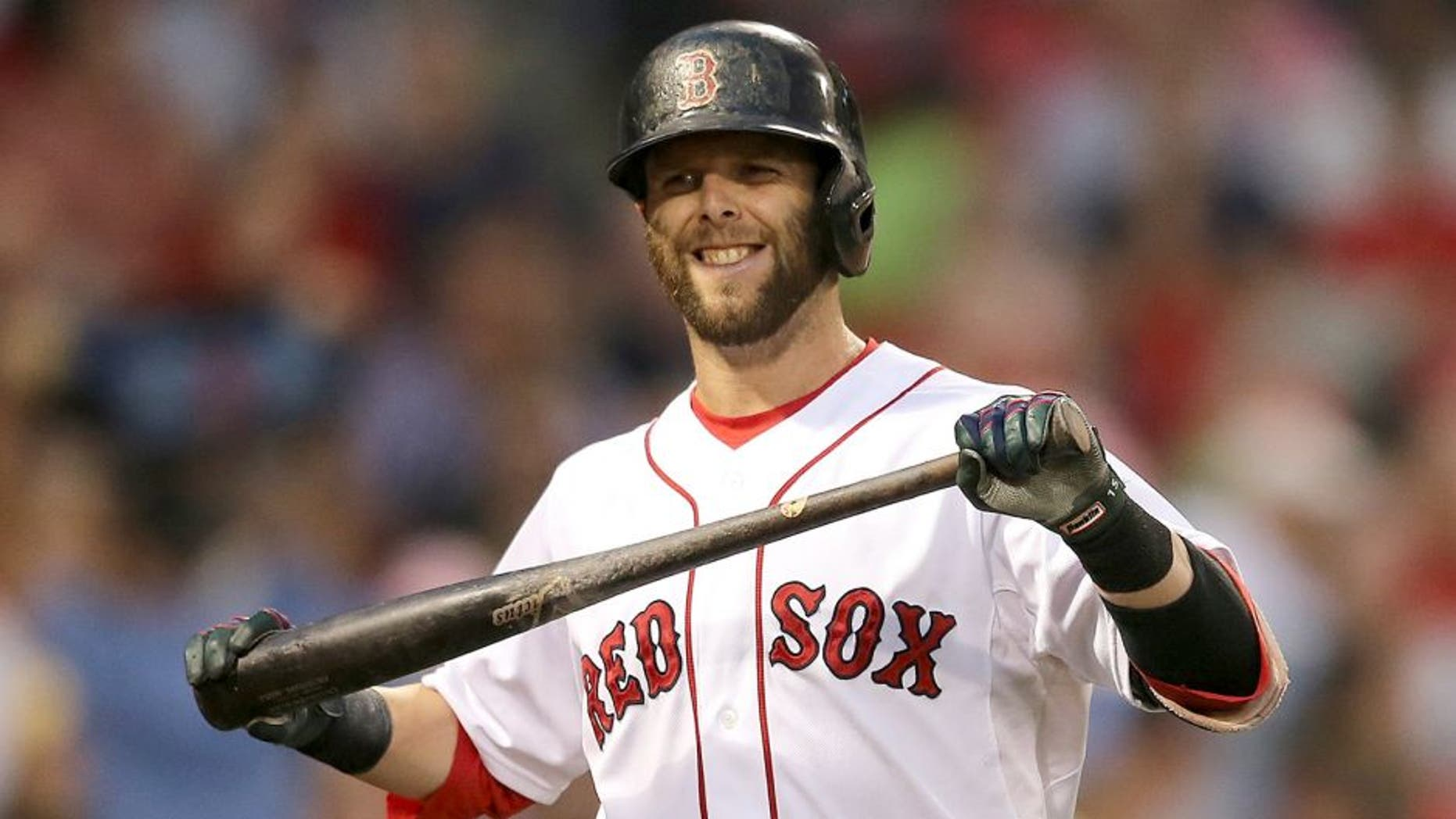 BOSTON, MA - JUNE 23: Dustin Pedroia #15 of the Boston Red Sox reacts after he struck out against the Baltimore Orioles in the fourth inning at Fenway Park on June 23, 2015 in Boston, Massachusetts. (Photo by Jim Rogash/Getty Images)