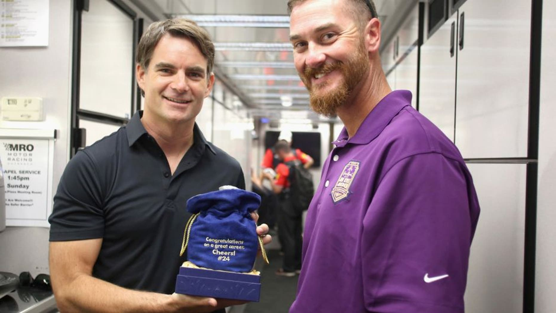INDIANAPOLIS, IN - JULY 25: Brickyard 400 namesake Jeff Kyle presents a bottle of Crown Royal XR to Jeff Gordon at Indianapolis Motor Speedway on July 25, 2015 in Indianapolis, Indiana. (Photo by Marianna Massey/Getty Images for Crown Royal) *** Local Caption *** Jeff Gordon;Jeff Kyle