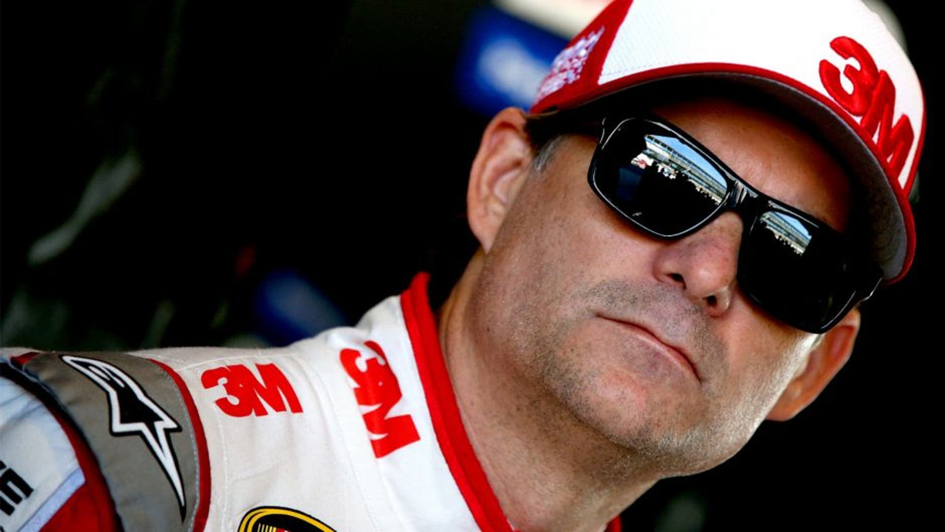 INDIANAPOLIS, IN - JULY 24: Jeff Gordon, driver of the #24 3M Chevrolet, stands in the garage area during practice for the NASCAR Sprint Cup Series Crown Royal Presents the Jeff Kyle 400 at the Brickyard at Indianapolis Motorspeedway on July 24, 2015 in Indianapolis, Indiana. (Photo by Sean Gardner/NASCAR via Getty Images)
