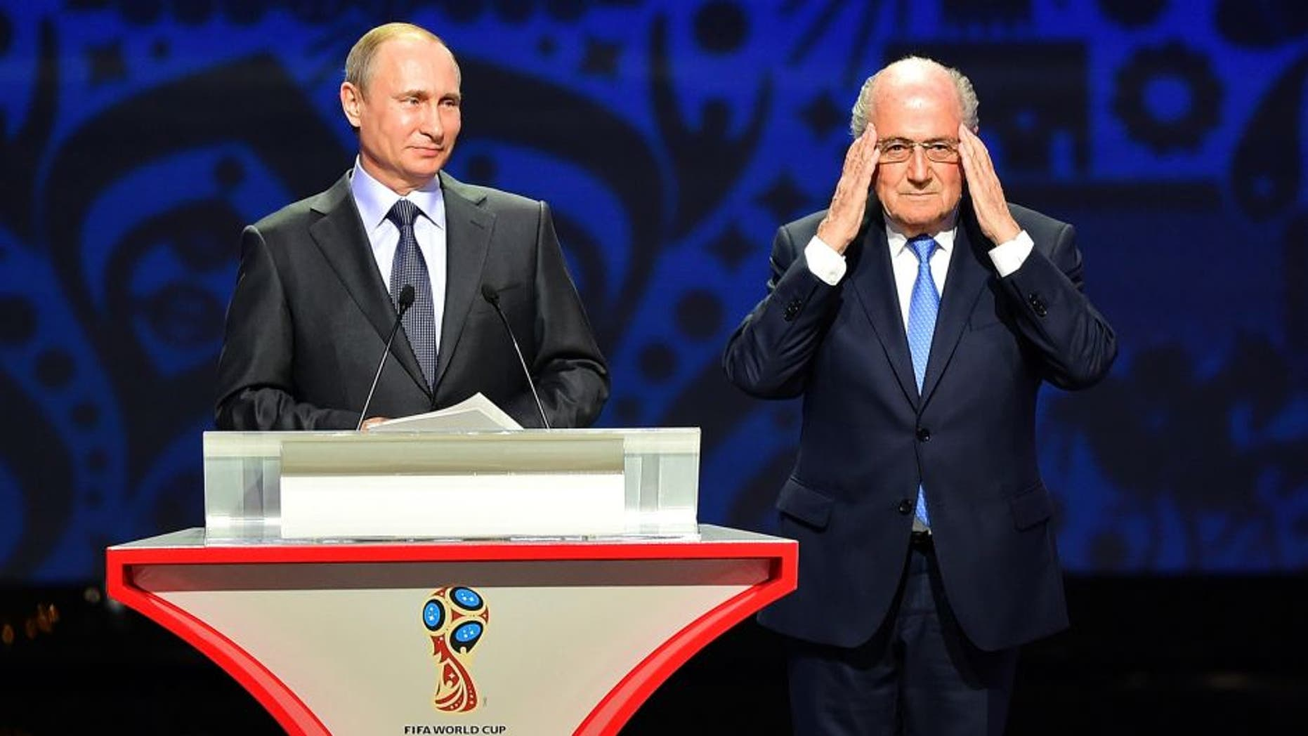SAINT PETERSBURG, RUSSIA - JULY 25: Vladimir Putin, President of Russia and FIFA President Joseph S. Blatter speak during the Preliminary Draw of the 2018 FIFA World Cup in Russia at The Konstantin Palace on July 25, 2015 in Saint Petersburg, Russia. (Photo by Shaun Botterill/Getty Images)