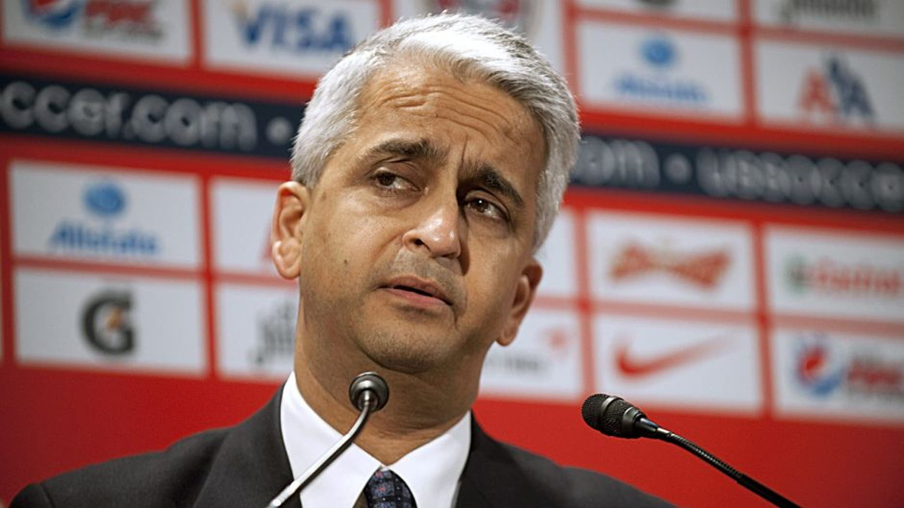 US Soccer President Sunil Gulati introduces German soccer star Jürgen Klinsmann as the new head coach of the US Mens National Team at a press conference August 1, 2011 in New York. AFP PHOTO/DON EMMERT (Photo credit should read DON EMMERT/AFP/Getty Images)