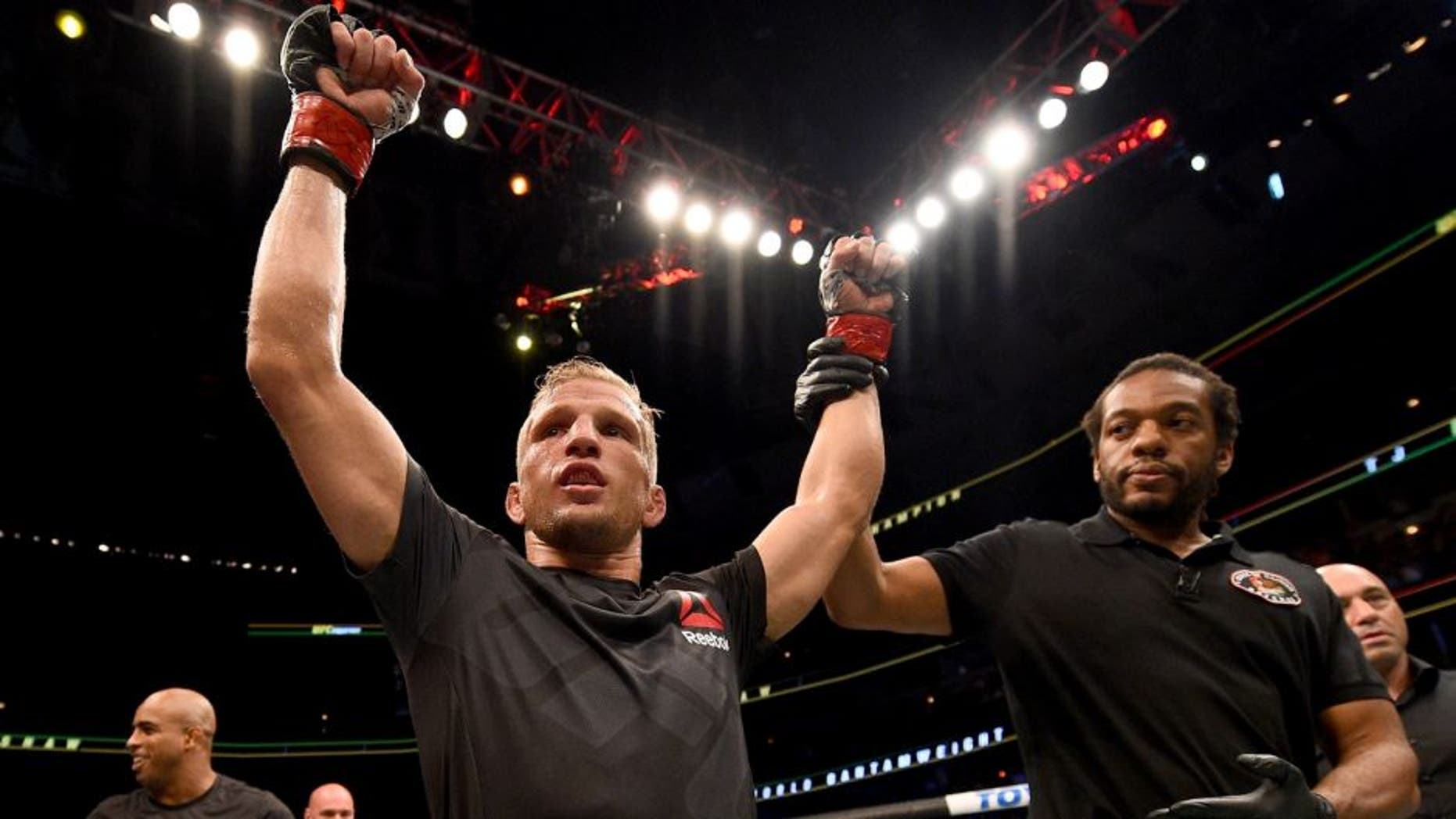 CHICAGO, IL - JULY 25: TJ Dillashaw celebrates after his TKO victory over Renan Barao of Brazil in their UFC bantamweight championship bout during the UFC event at the United Center on July 25, 2015 in Chicago, Illinois. (Photo by Jeff Bottari/Zuffa LLC/Zuffa LLC via Getty Images)