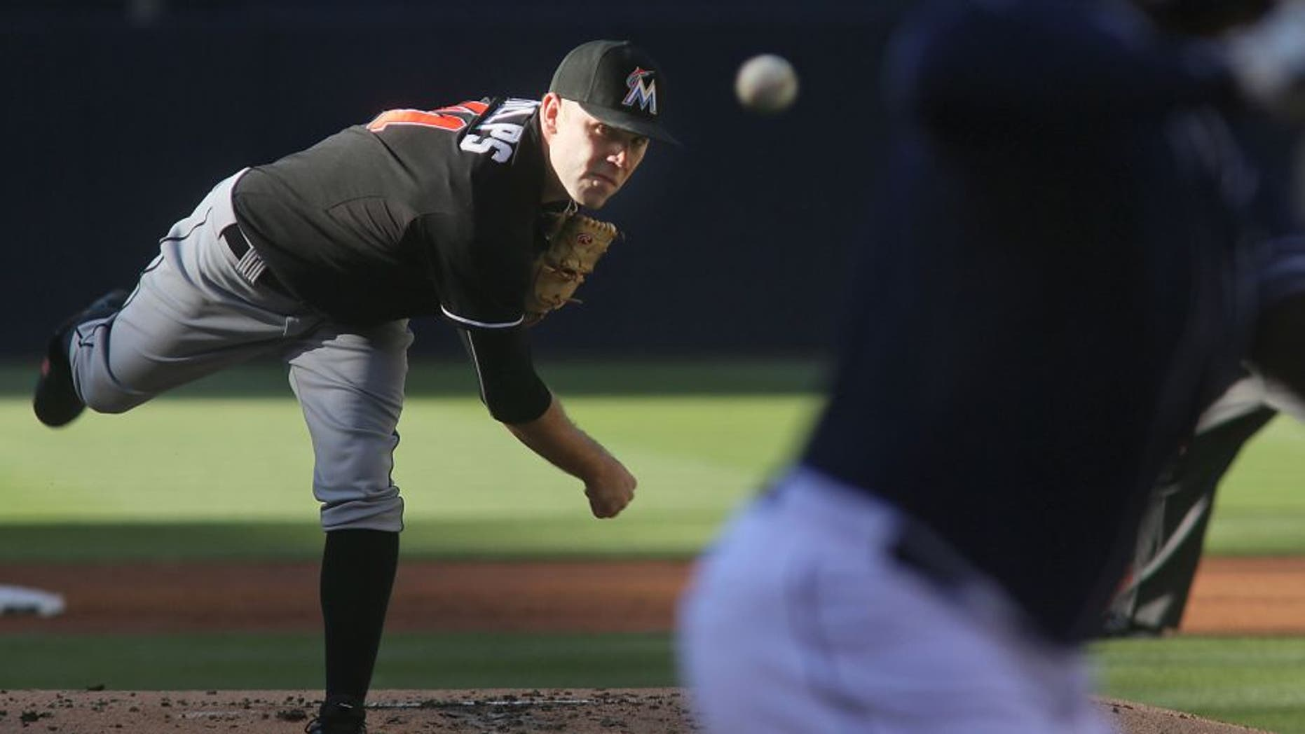 Miami Marlins starting pitcher David Phelps throws to a San Diego Padres batter during the first inning of a baseball game Saturday, July 25, 2015, in San Diego. (AP Photo/Sandy Huffaker)