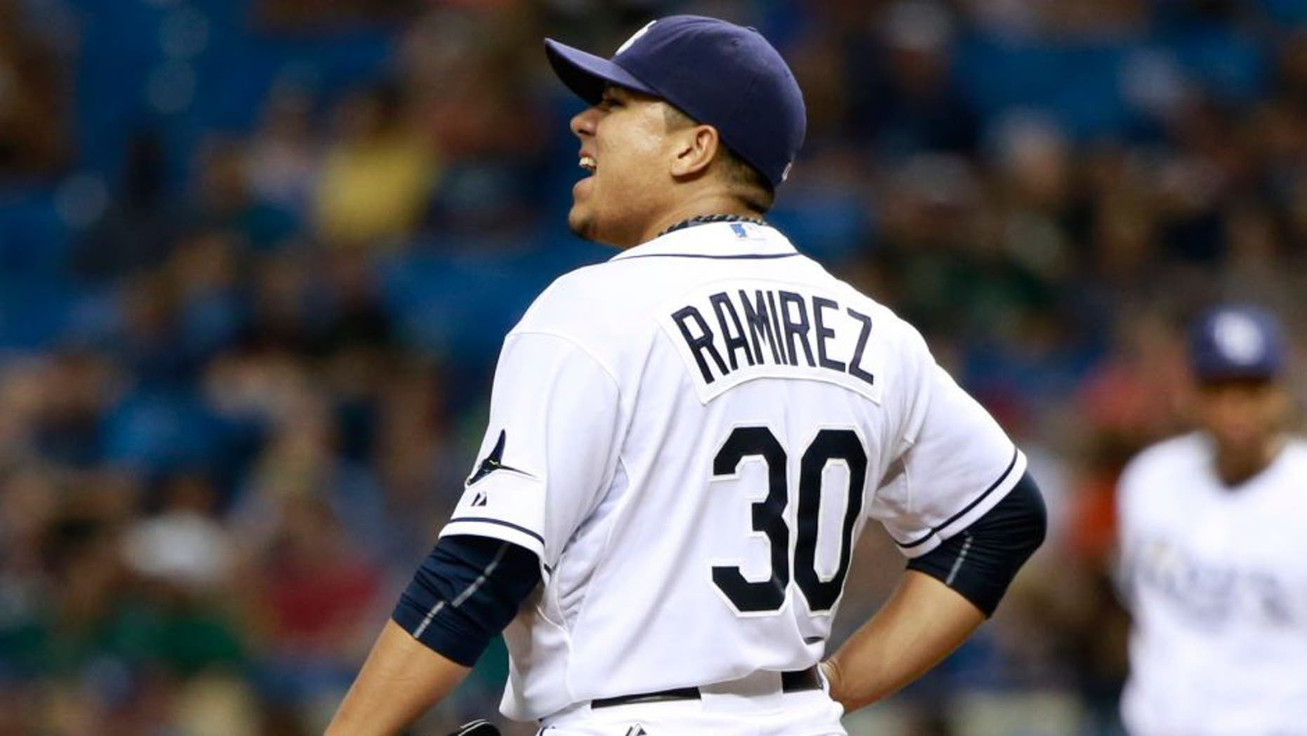 Jul 25, 2015; St. Petersburg, FL, USA; Tampa Bay Rays starting pitcher Erasmo Ramirez (30) reacts after giving up a grand slam during the third inning against the Tampa Bay Rays at Tropicana Field. Mandatory Credit: Kim Klement-USA TODAY Sports