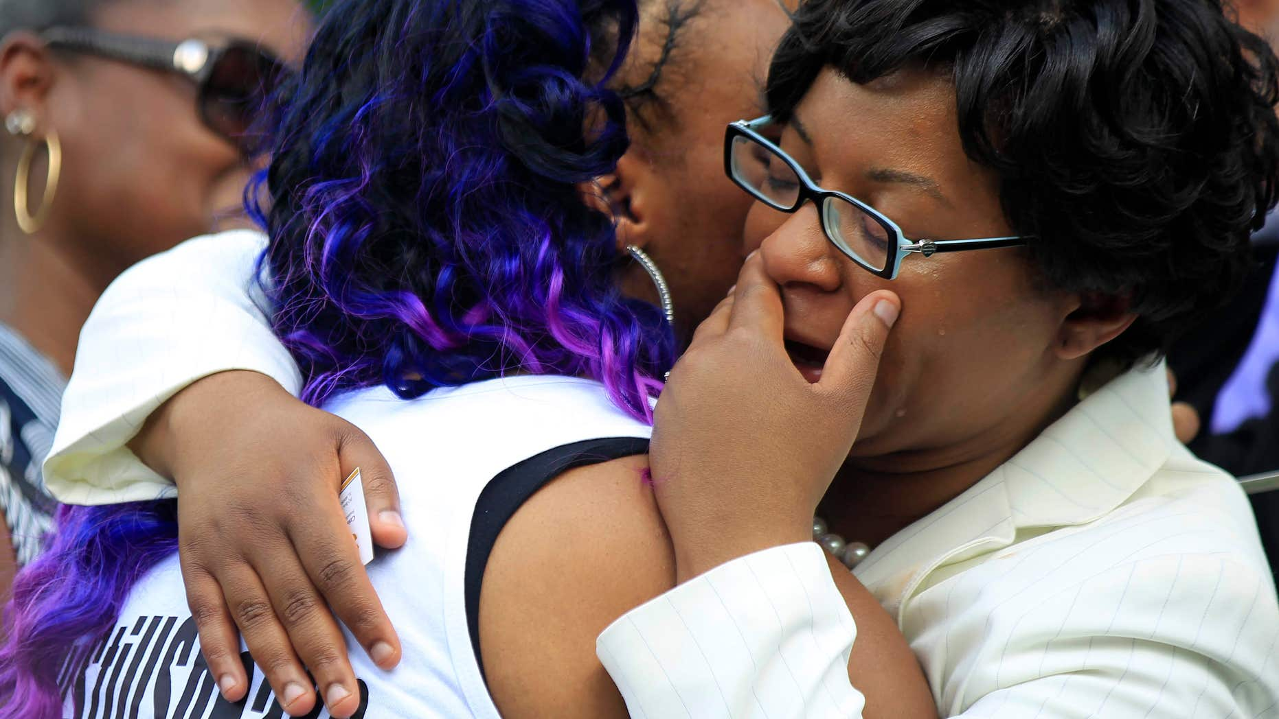 July 25, 2015: A mourner hugs Sandra Bland's sister Sharon Cooper at the Mt. Glenwood Memorial Gardens West cemetery in Willow Springs, Ill.
