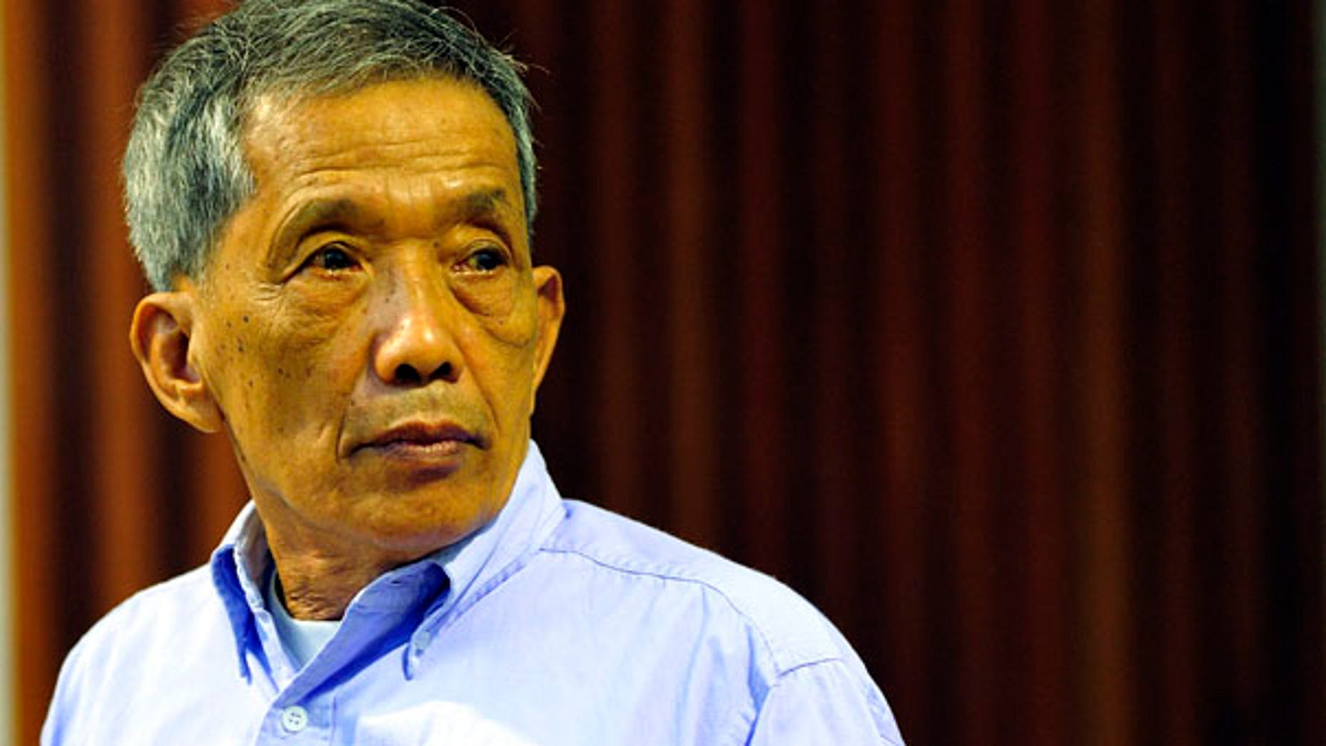 "July 26: Khmer Rouge jailer Kaing Guek Eav, who ran a top secret detention center for the worst ""enemies"" of the state, looks on during his sentencing at the U.N.-backed war crimes tribunal in Phnom Penh, Cambodia."